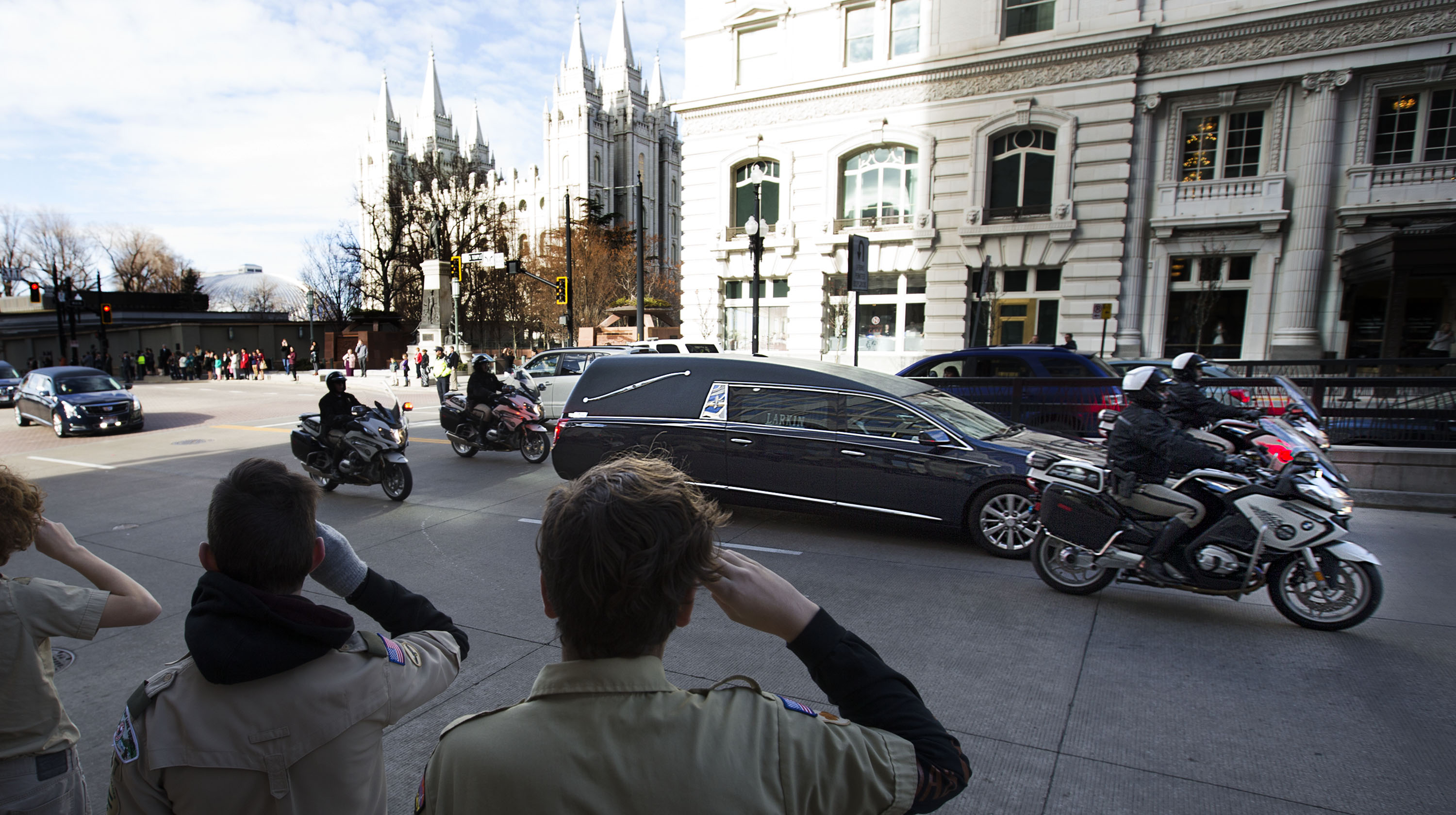 Mourners and Boy Scouts line South Temple as the funeral procession for President Thomas S. Monson makes its way to the Salt Lake City Cemetery on Friday, Jan. 12, 2018.