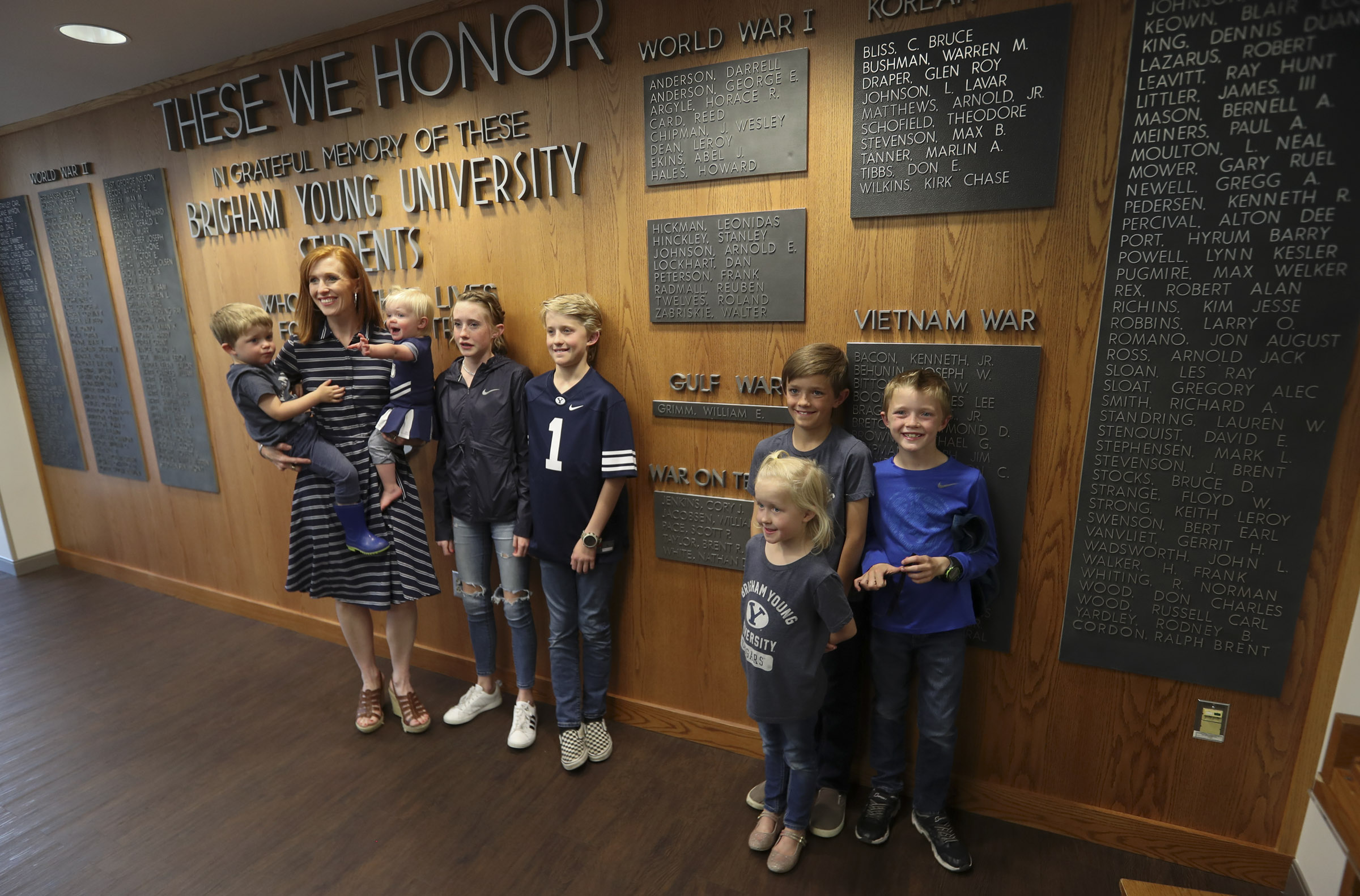 Jennie Taylor stands with her children following a ceremony where the name of her late husband, Maj. Brent Taylor, was added to the Reflection Room Memorial Wall in the Wilkinson Center on the BYU campus in Provo on Thursday, May 23, 2019. Taylor was killed in Afghanistan in 2018.