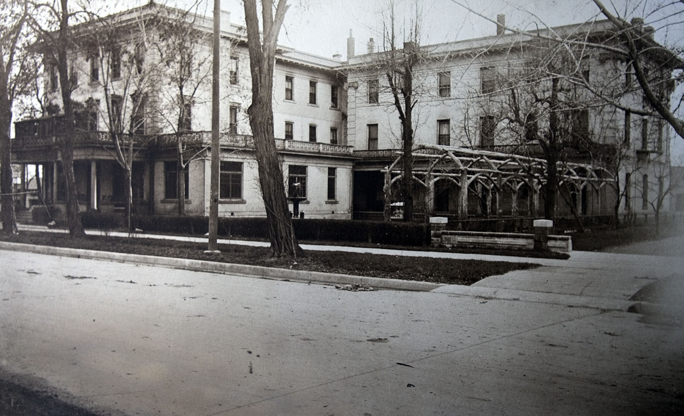 """The Roberts Hotel in downtown Provo was the first residence all for missionaries. Because the decision to create the Missionary Language Institute evolved rather quickly in 1961, there was not enough time to obtain the already occupied campus housing. After six months, housing was located nearer the campus, although missionaries stayed in the hotel off and on during the 1960s when other rooms were unavailable. At times, missionaries occupied the entire top floor."" — This is the caption information found on the frame plaque accompany this photo, one nearly dozen historical photos showing the development of the Language Training Mission and Missionary Training Center facilities in Provo since the 1960s."