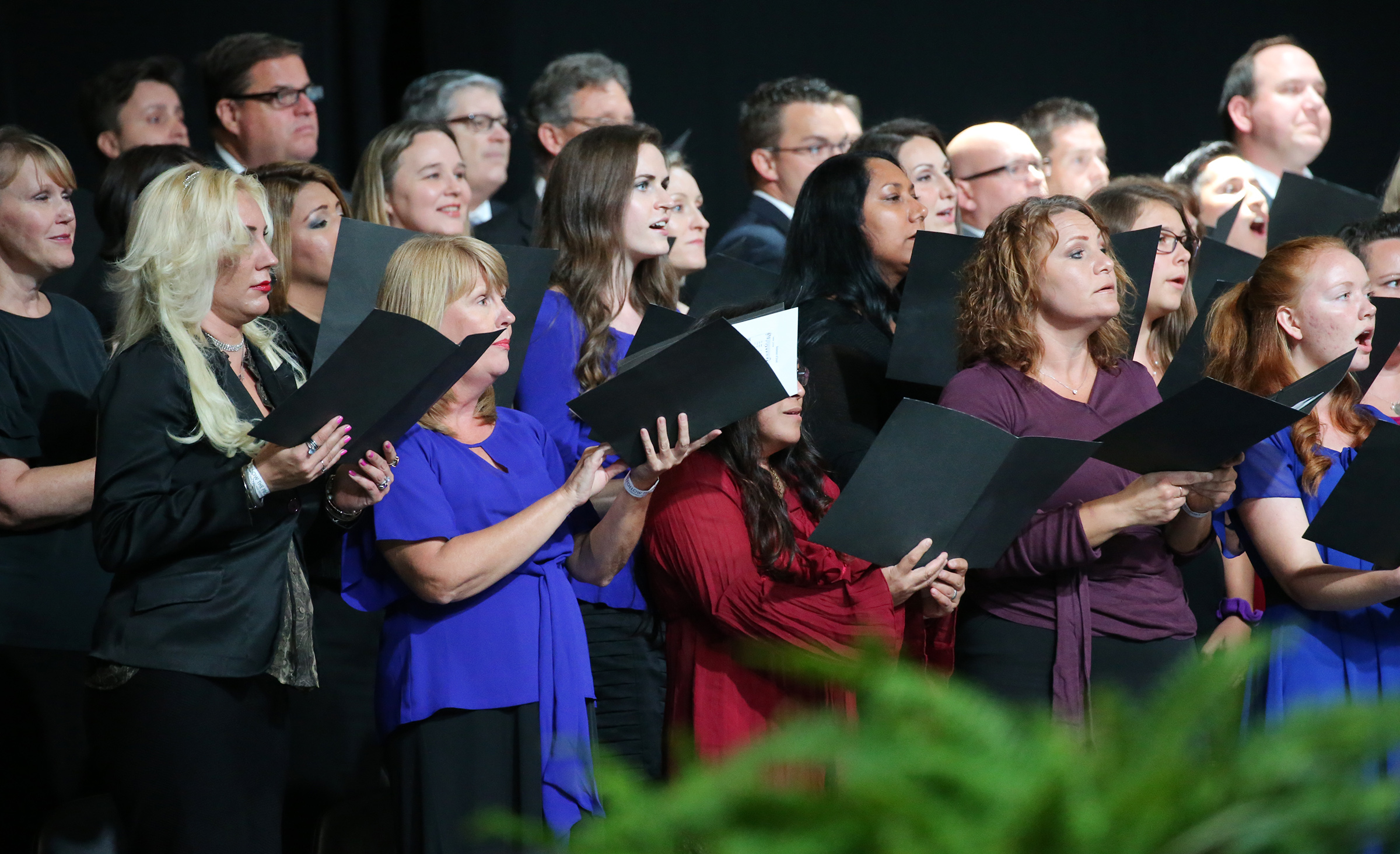 Choir members sing at a devotional with President Russell M. Nelson and others at the Amway Center in Orlando, Florida, on Sunday, June 9, 2019.