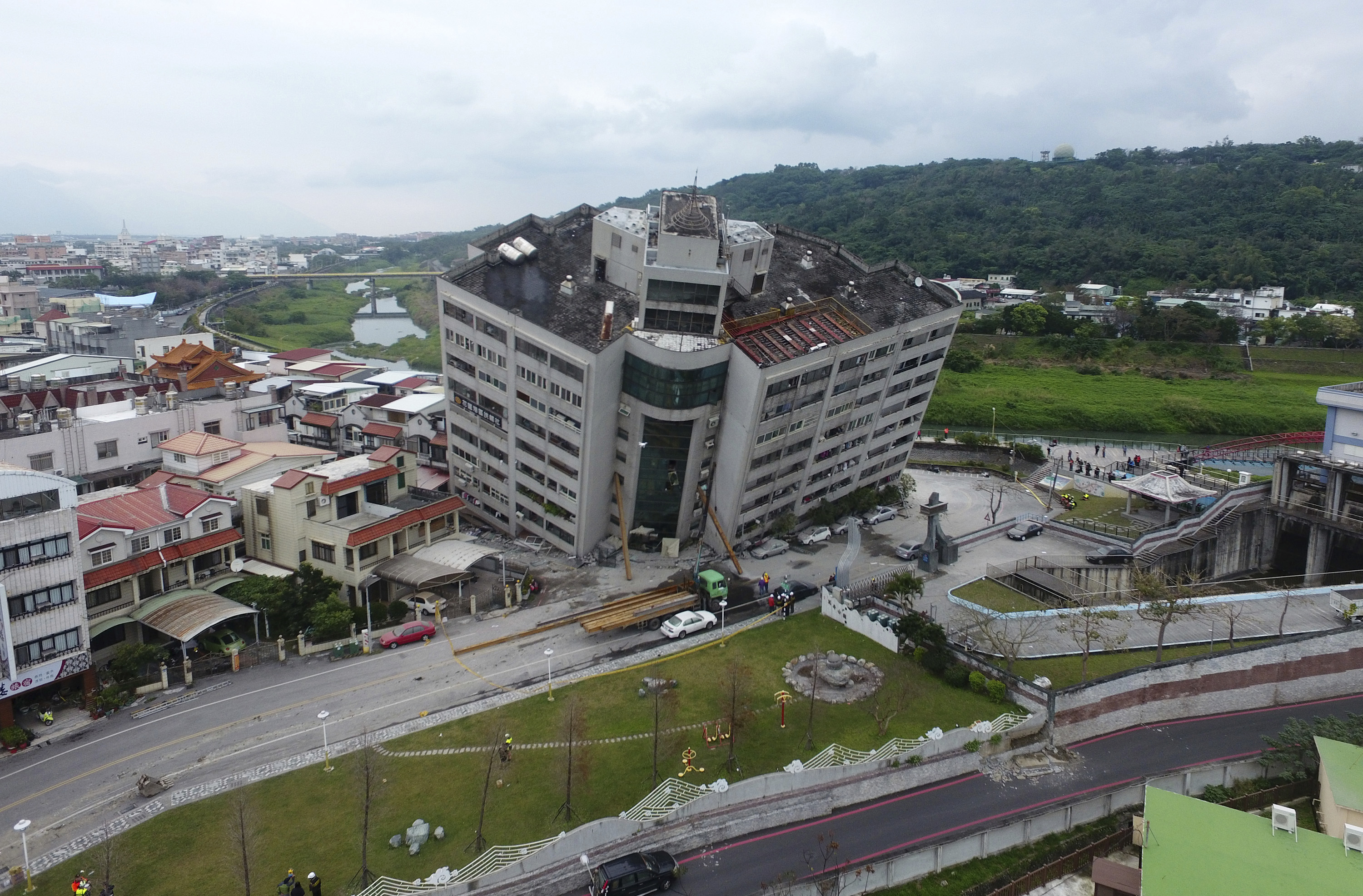 A building leans on a collapsed first floor following an earthquake, Wednesday, Feb. 7, 2018, in Hualien, southern Taiwan.