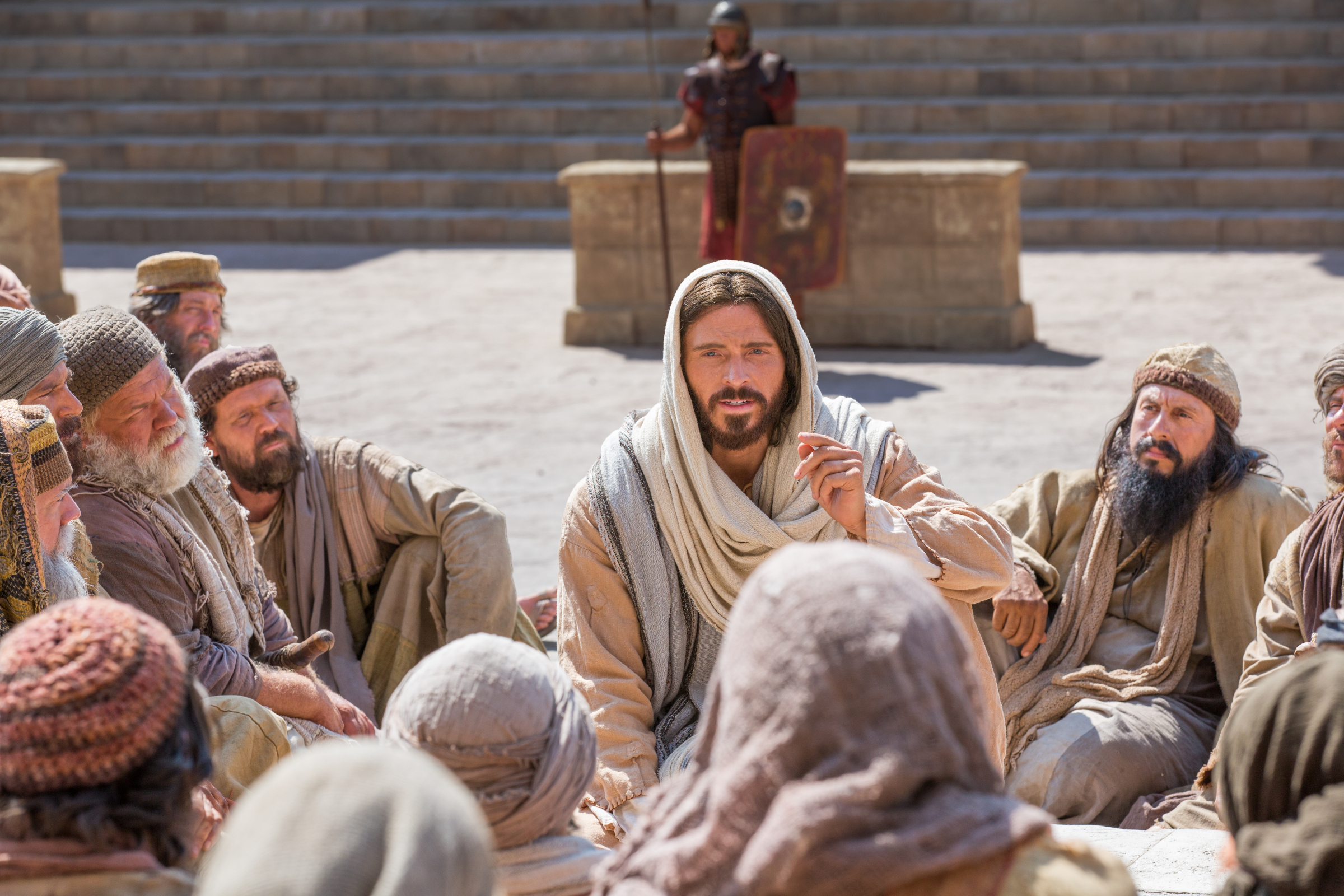 Jesus Christ tells a group of people that he is the Good Shepherd in this image from the Bible Video.