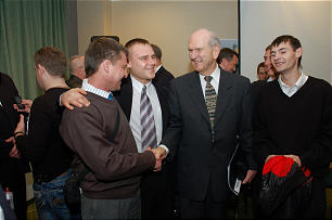 Elder Russell M. Nelson converses with young men after Priesthood leadership training in Samara, Russia, on Oct. 23-25, 2009.