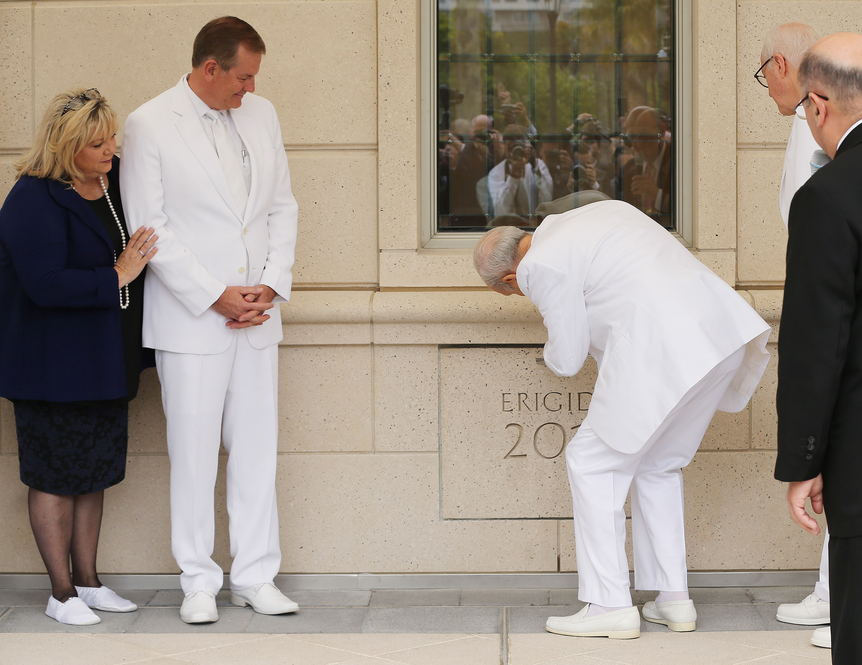 Elder Gary E. Stevenson of the Quorum of the Twelve Apostles and his wife, Sister Lesa Stevenson, watch as President Russell M. Nelson of The Church of Jesus Christ of Latter-day Saints places mortar in the cornerstone during the dedication of the Concepcion Chile Temple on Sunday, Oct. 28, 2018, in Concepcion, Chile.