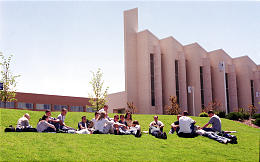 A summer class takes advantage of warm sunshine on Ricks College campus. When classes begin in autumn, student enrollment is expected to jump from 9,000 to 11,600.