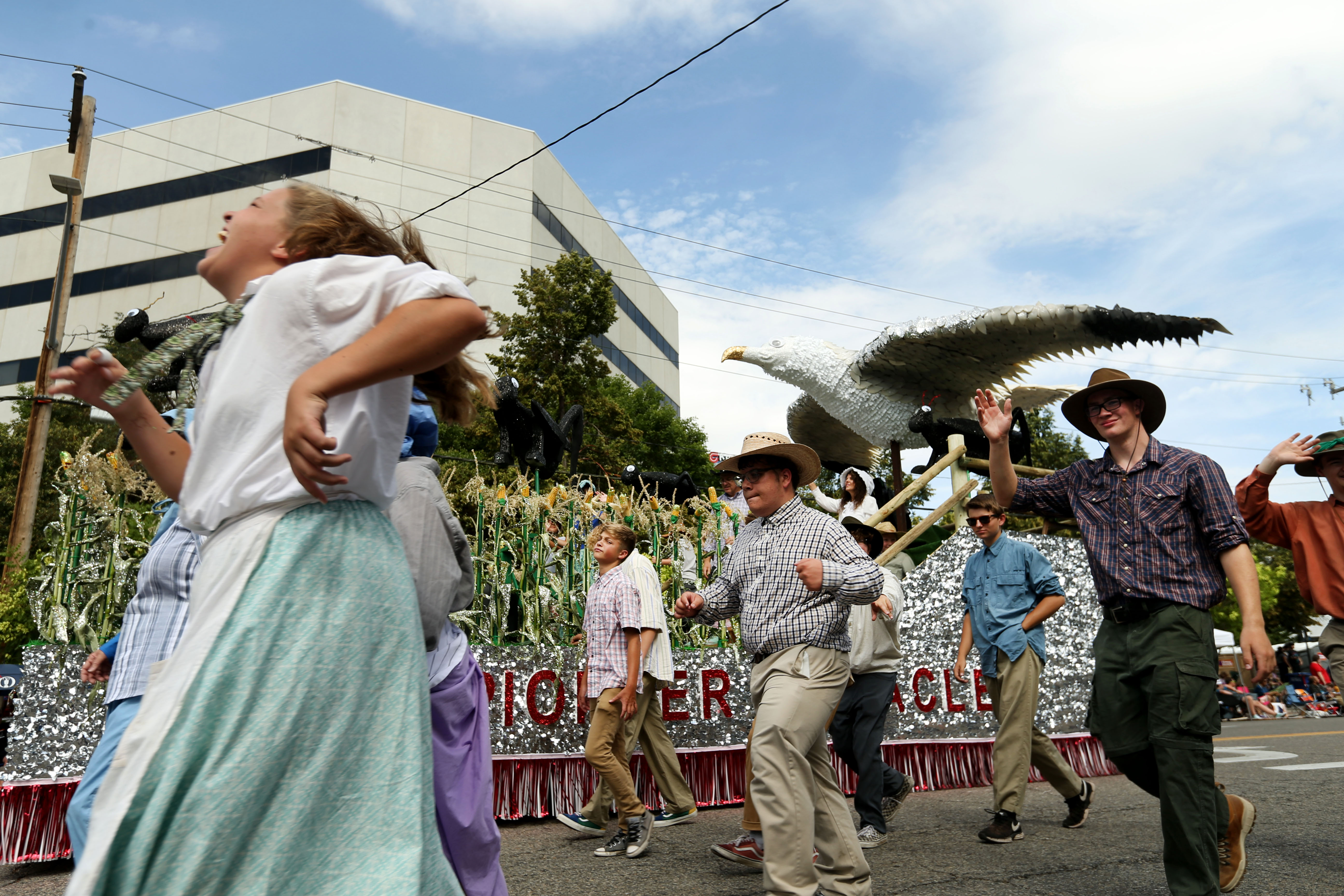 People dressed as pioneers march with a float decorated with seagulls during the Days of '47 Parade in Salt Lake City on Wednesday, July 24, 2019.