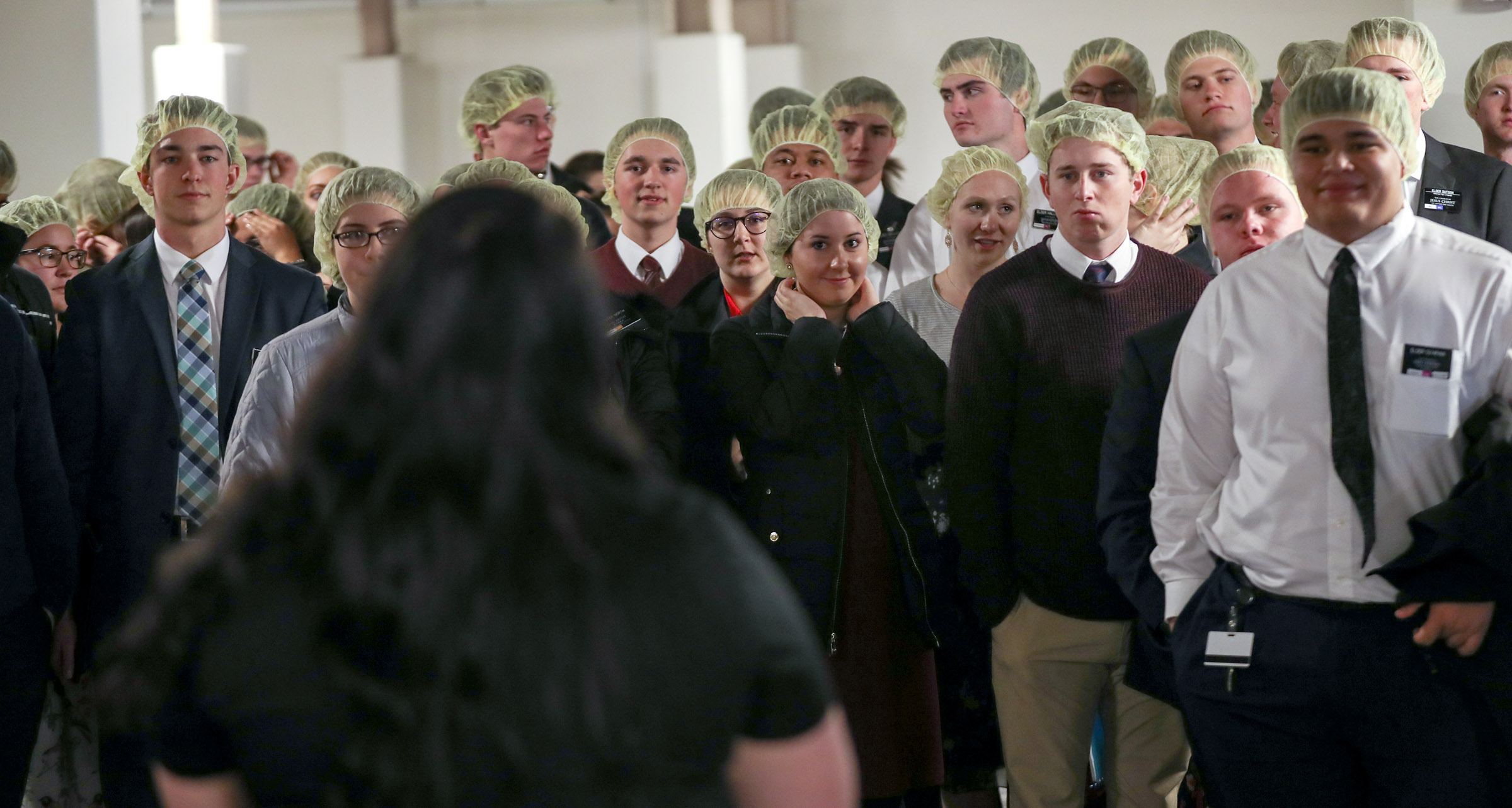 Missionaries serving at the Missionary Training Center in Provo get instructions as they participate in an annual service project with Feeding Children Everywhere to address the issue of domestic hunger. Working in a covered parking garage, the group assembled more than 350,000 meals for the Utah Food Bank on Thursday, Nov. 22, 2018.
