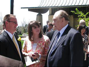 Funeral of Elder Jack H. Goaslind Jr. on May 2, 2011.Tuesday, May3, 2011. After funeral, outside the stake center, President Thomas S. Monson converses with Adam and Sarah Goaslind, grandson and granddaughter-in-law of Elder Goaslind.