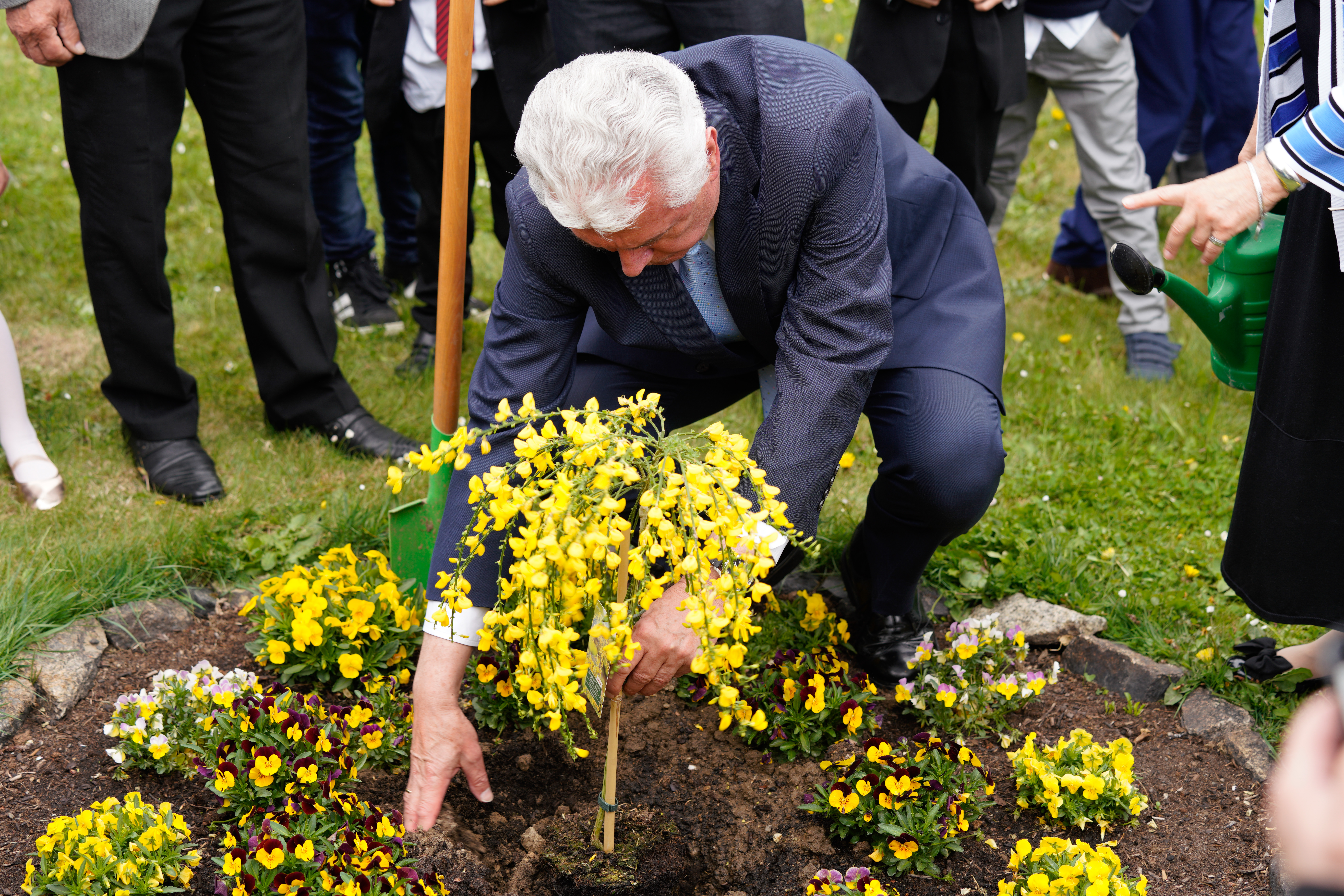 Elder Dieter F. Uchtdorf helps plants a ginster bush on the meetinghouse property commemorating the Görlitz Branch's 120th annivers on April 28, 2019, in Görlitz, Germany.