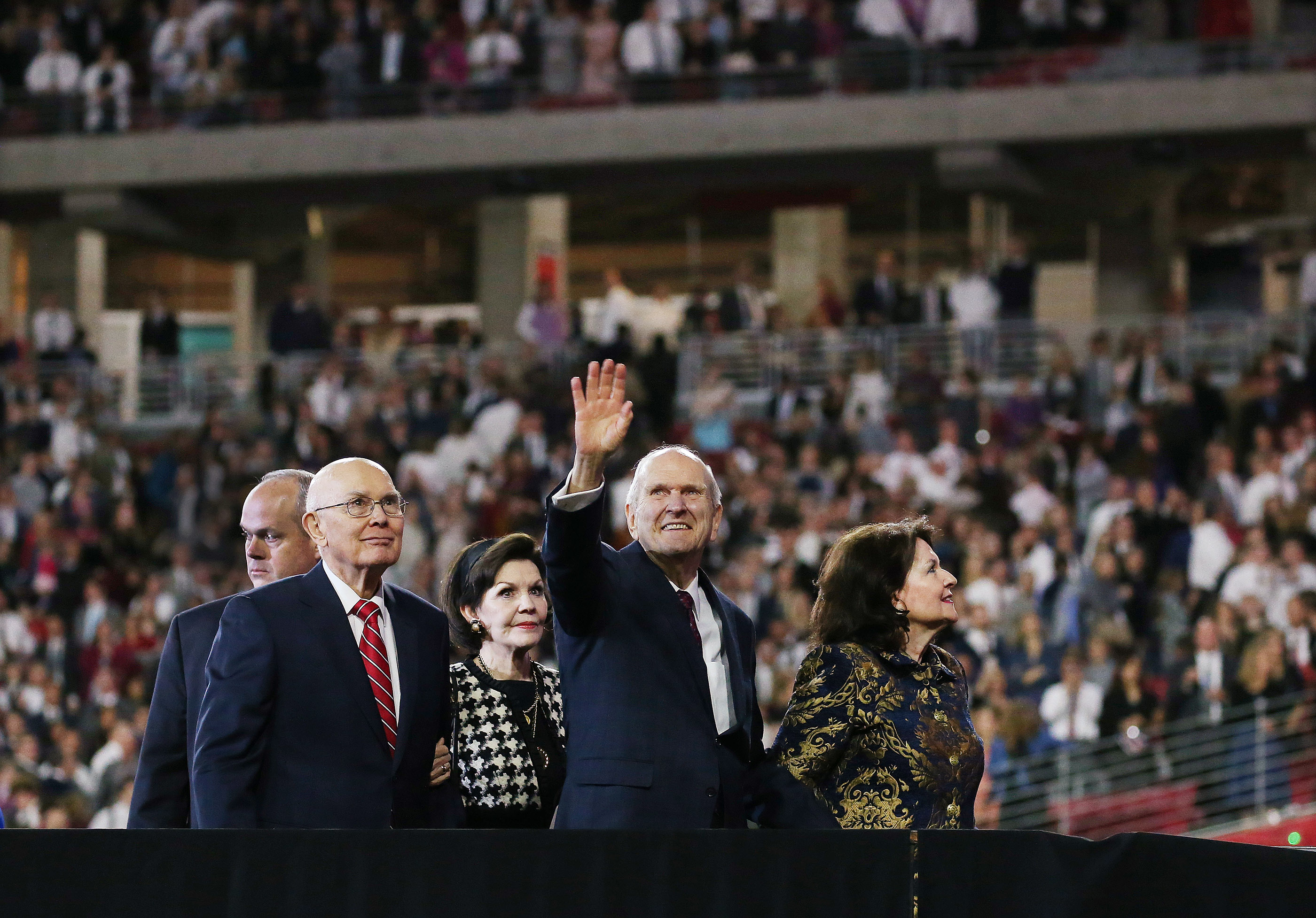 President Russell M. Nelson of The Church of Jesus Christ of Latter-day Saints waves to attendees after speaking at the State Farm Stadium in Phoenix on Sunday, Feb. 10, 2019. President Nelson is accompanied by his wife, Sister Wendy Nelson; President Dallin H. Oaks, first counselor in the Church's First Presidency; and his wife, Sister Kristen Oaks.