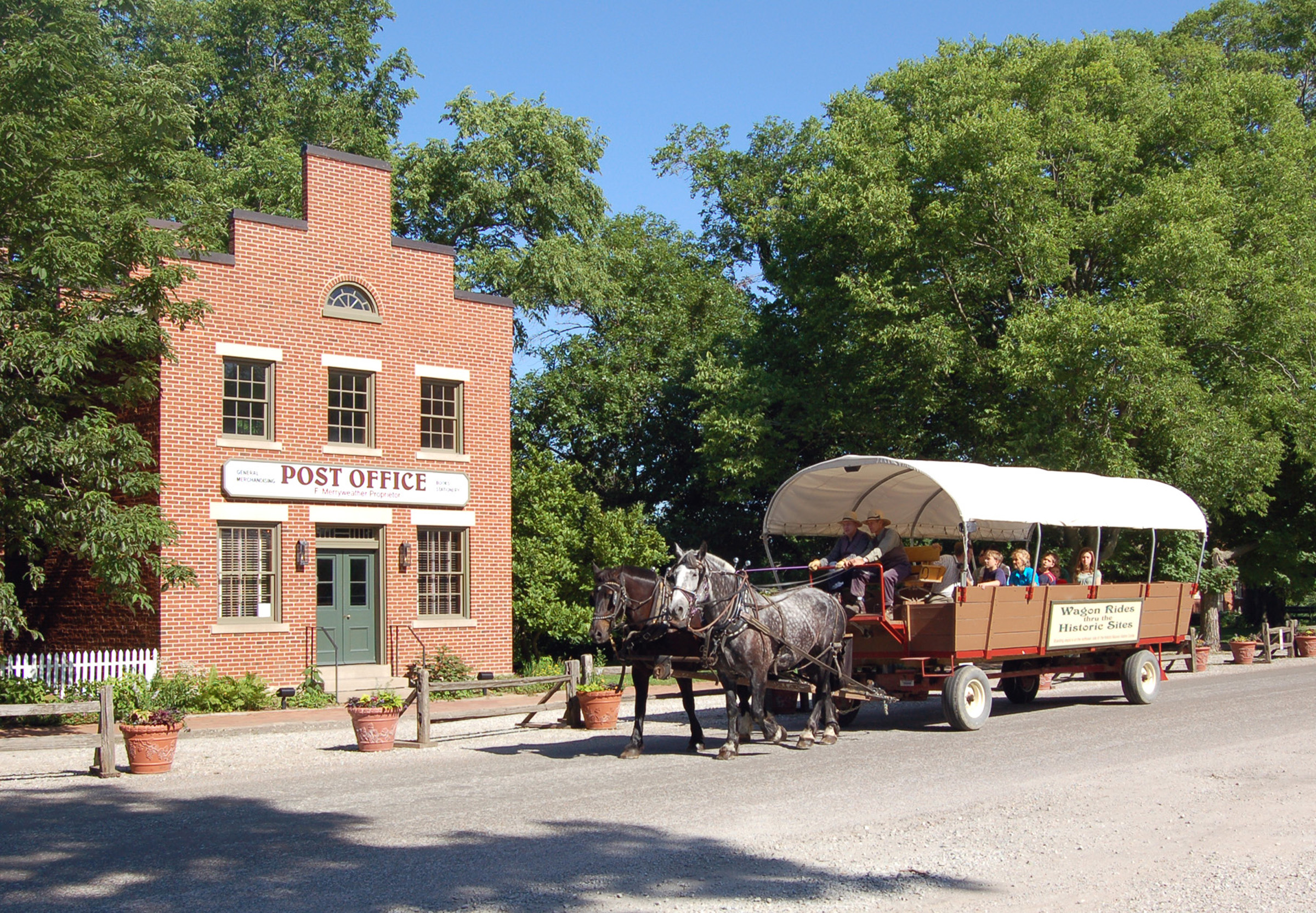 A group on a wagon ride goes past the post office in historic Nauvoo. Wagon rides are free in Nauvoo.