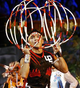 One of the many dancers participates in the final dress rehearsal for the LDS progarm, Luz de las Naciones (Light of the Nations) at the LDS conference center in Salt Lake City Thursday, Oct. 25, 2012