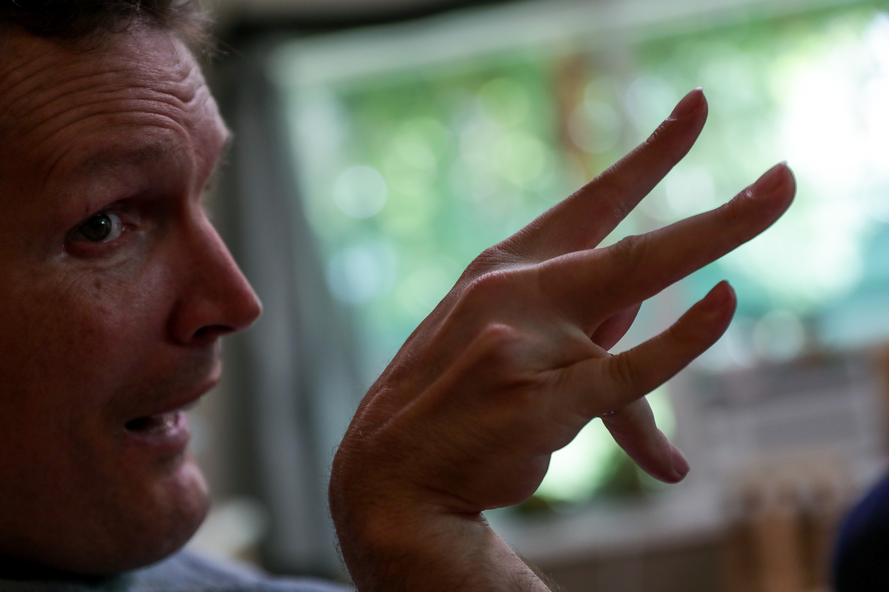 Orin Voorheis uses an abbreviated sign language, fondly referred to as Orin-ese by friends and family, to communicate at home in Pleasant Grove, Utah, on Tuesday, July 10, 2018.