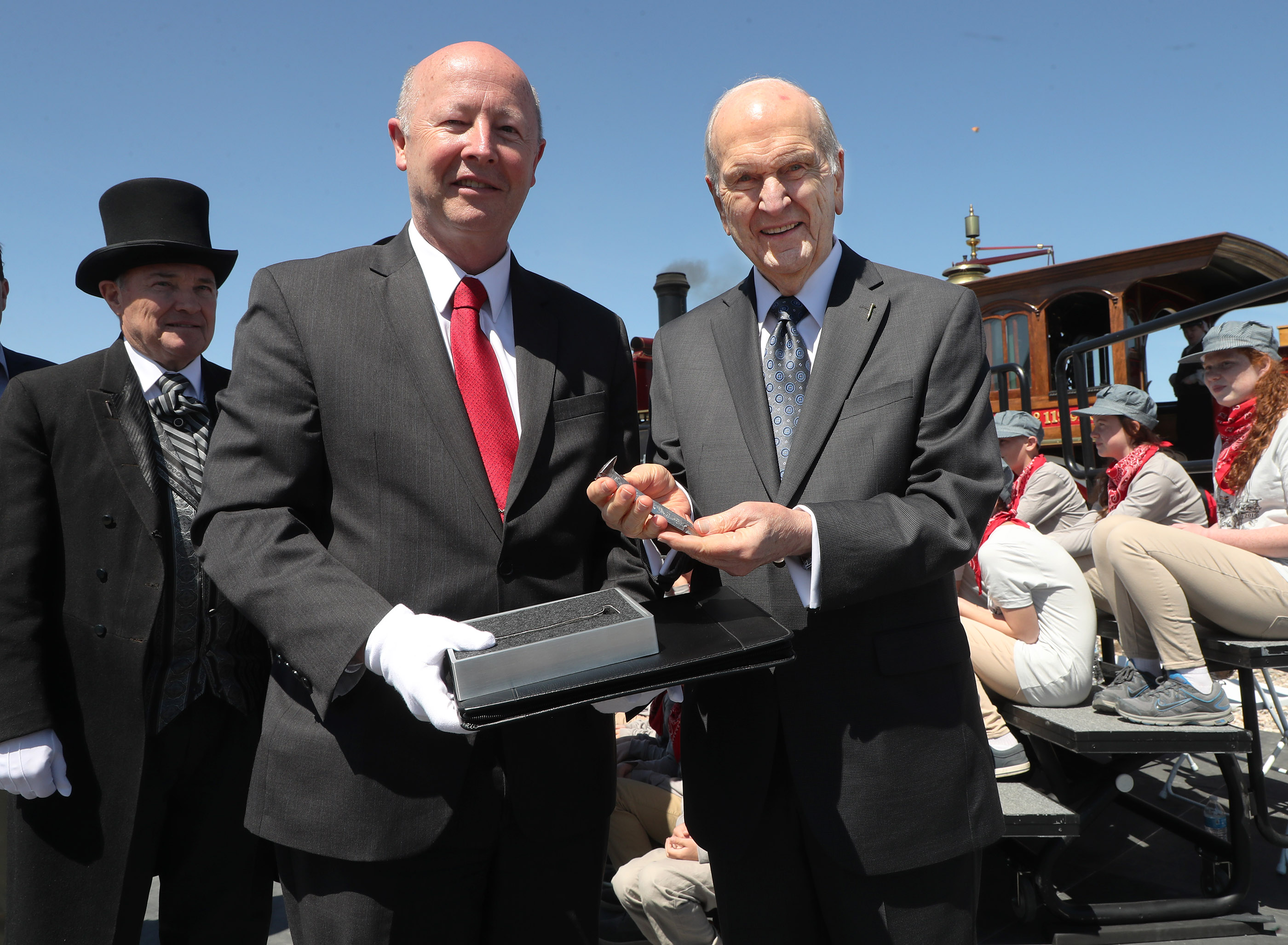 President Russell M. Nelson of The Church of Jesus Christ of Latter-day Saints, and historian Rick Turley hold the historic Utah spike during the 150th anniversary celebration of the transcontinental railroad at the Golden Spike National Historical Park in Promontory Summit on Friday, May 10, 2019.
