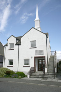 Stornoway Branch meetinghouse is centrally located on Stornoway's waterfront. Town's tourist map lists building.