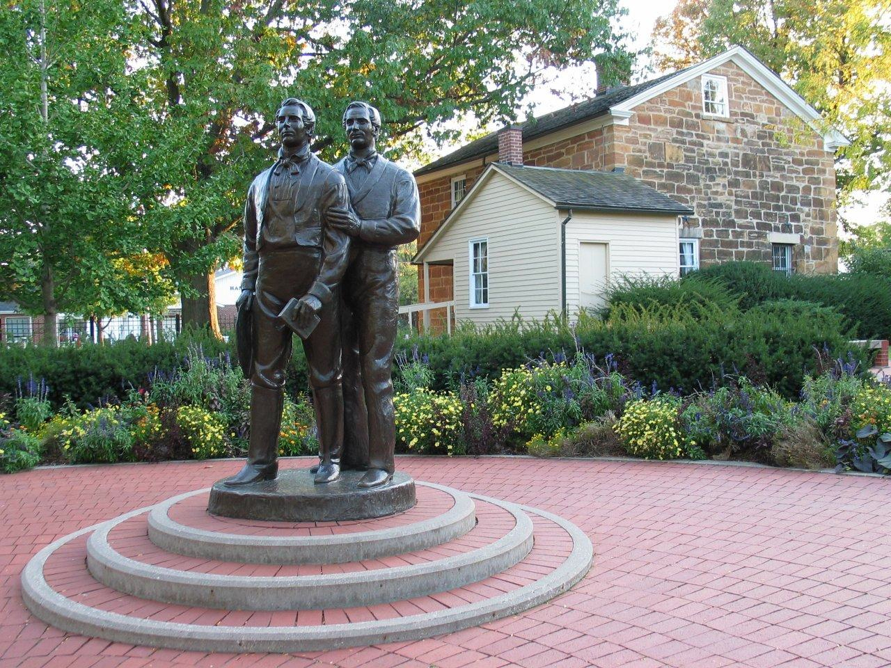 A statue of Joseph and Hyrum Smith stands outside Carthage Jail in Carthage, Illinois.