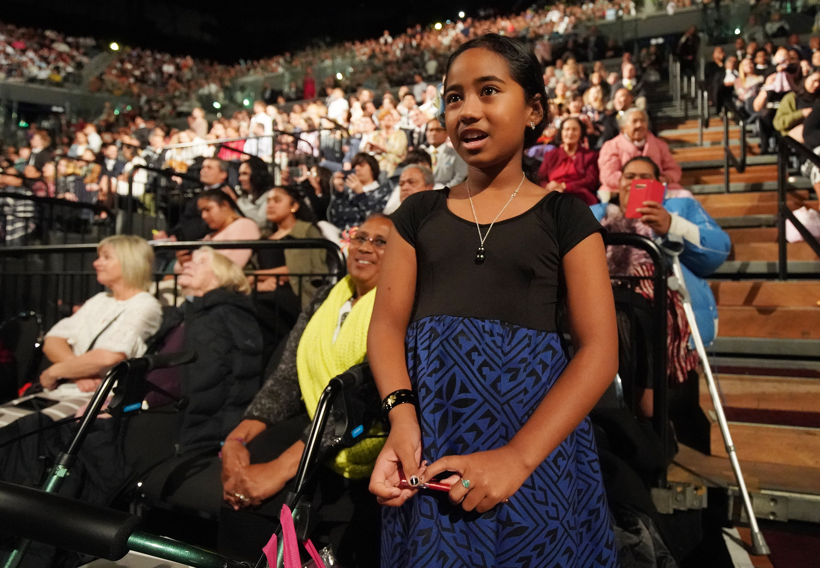 Jadarose Kapsin-Mani, 10, sings after President Russell M. Nelson of The Church of Jesus Christ of Latter-day Saints asked Primary-age children to sing during a devotional at Spark Arena in Auckland, New Zealand on May 21, 2019.