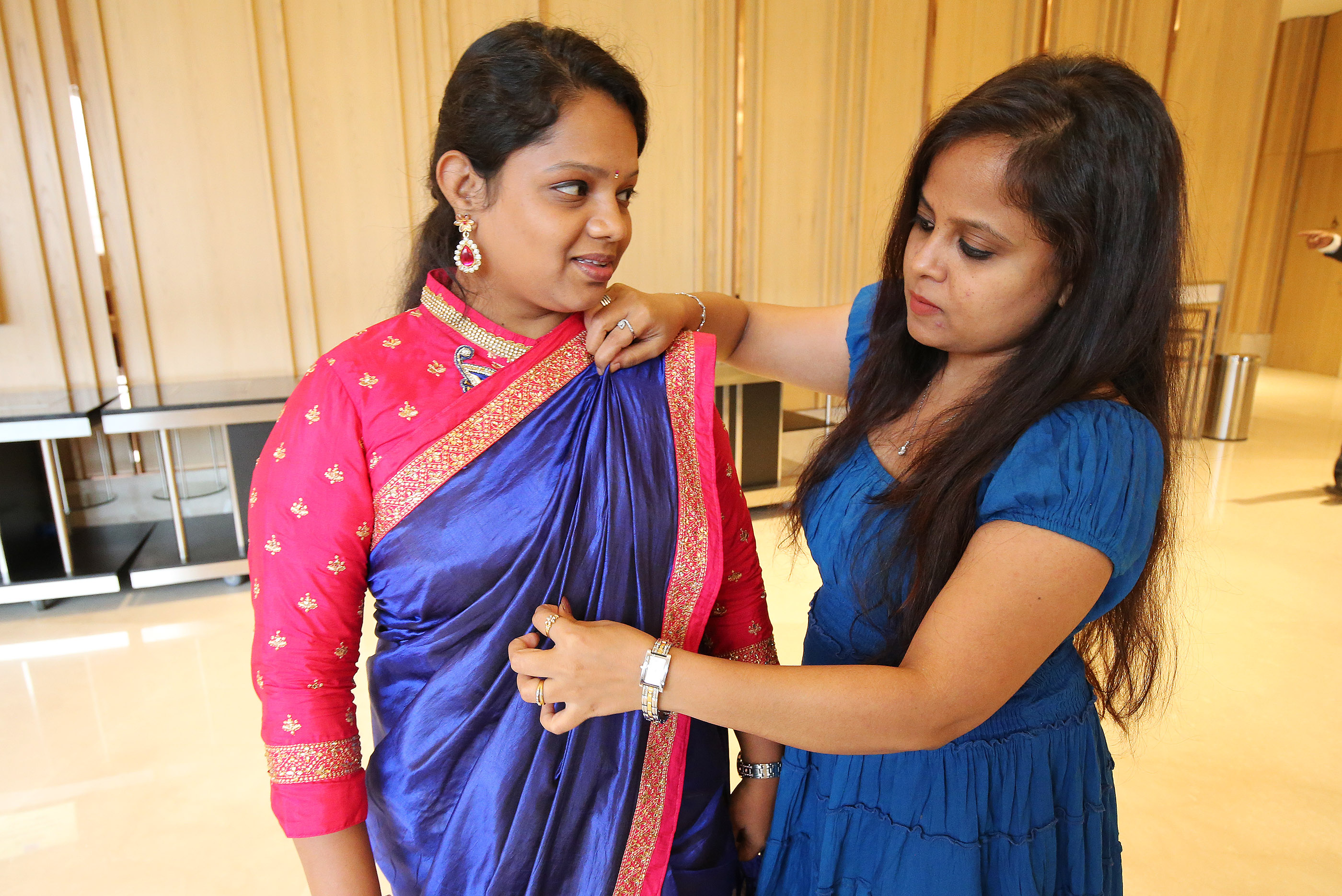 Anitha Louis, right, helps Asha Kiran prior to a devotional with President Russell M. Nelson in Bengaluru, India, on Thursday, April 19, 2018.