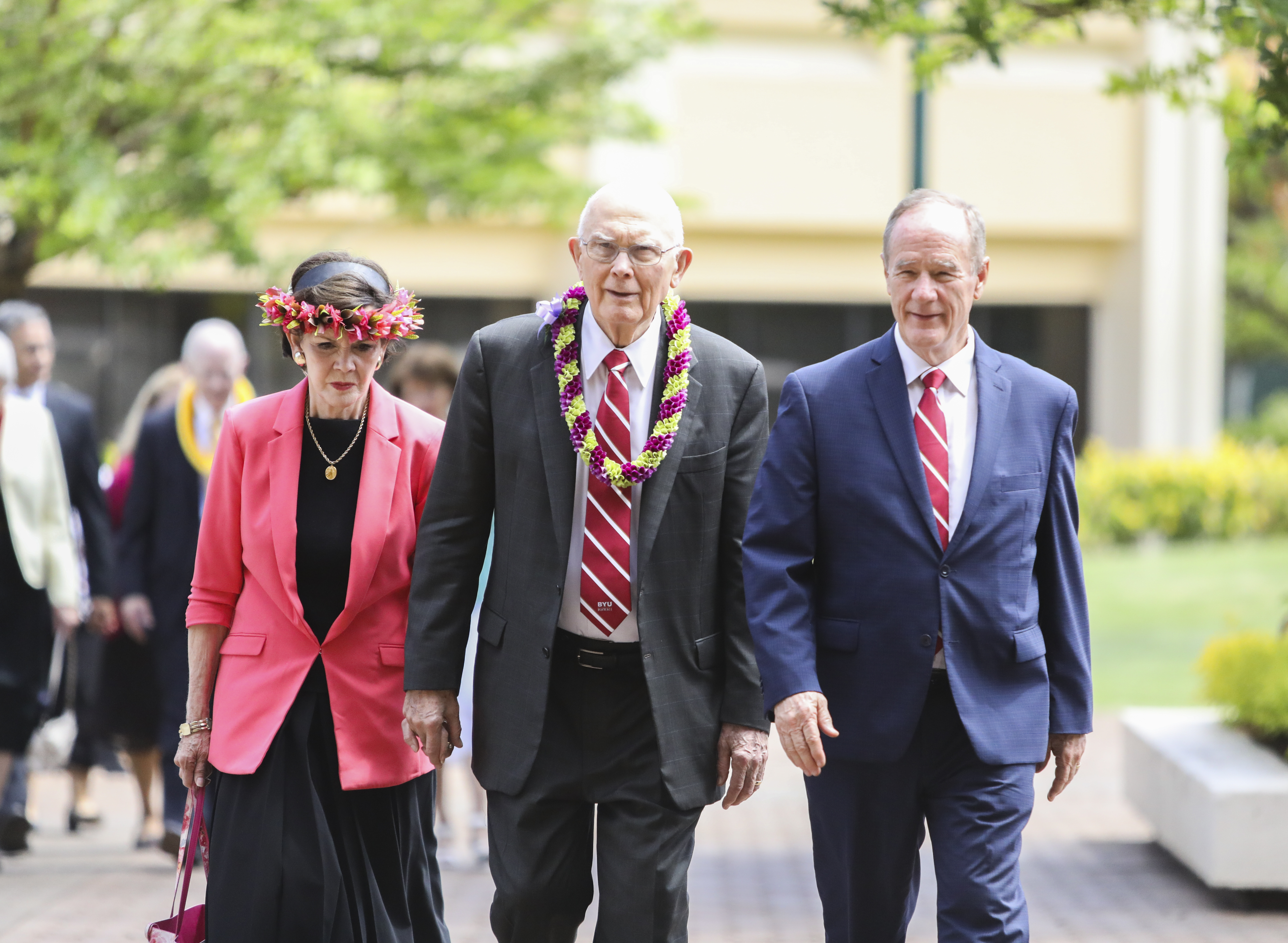 President Dallin H. Oaks, center, arrives at the George Q. Cannon Activities Center with his wife, Sister Kristen Oaks, and BYU-Hawaii President John S. Tanner, before a devotional on June 11, 2019.