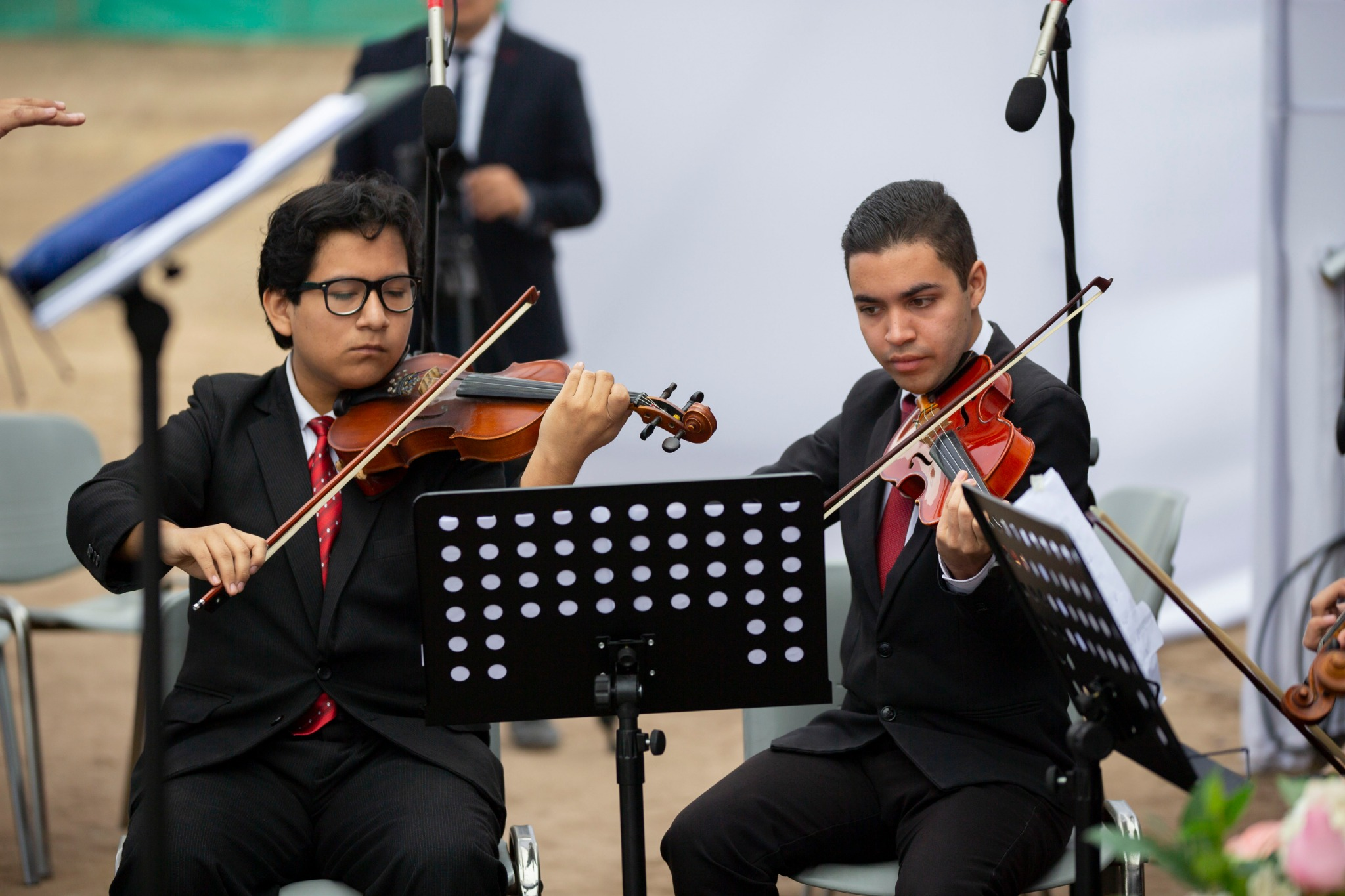 A choir and youth orchestra of Latter-day Saints provide music for the groundbreaking ceremony of the Lima Peru Los Olivos Temple on Saturday, June 8, 2019.