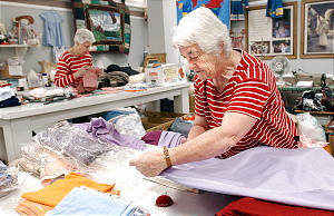(Right to left) Dorothy Arnold and May Arnold work on quilts at the Humanitarian Service Room at Deseret Industries in Murray on December 4, 2001.