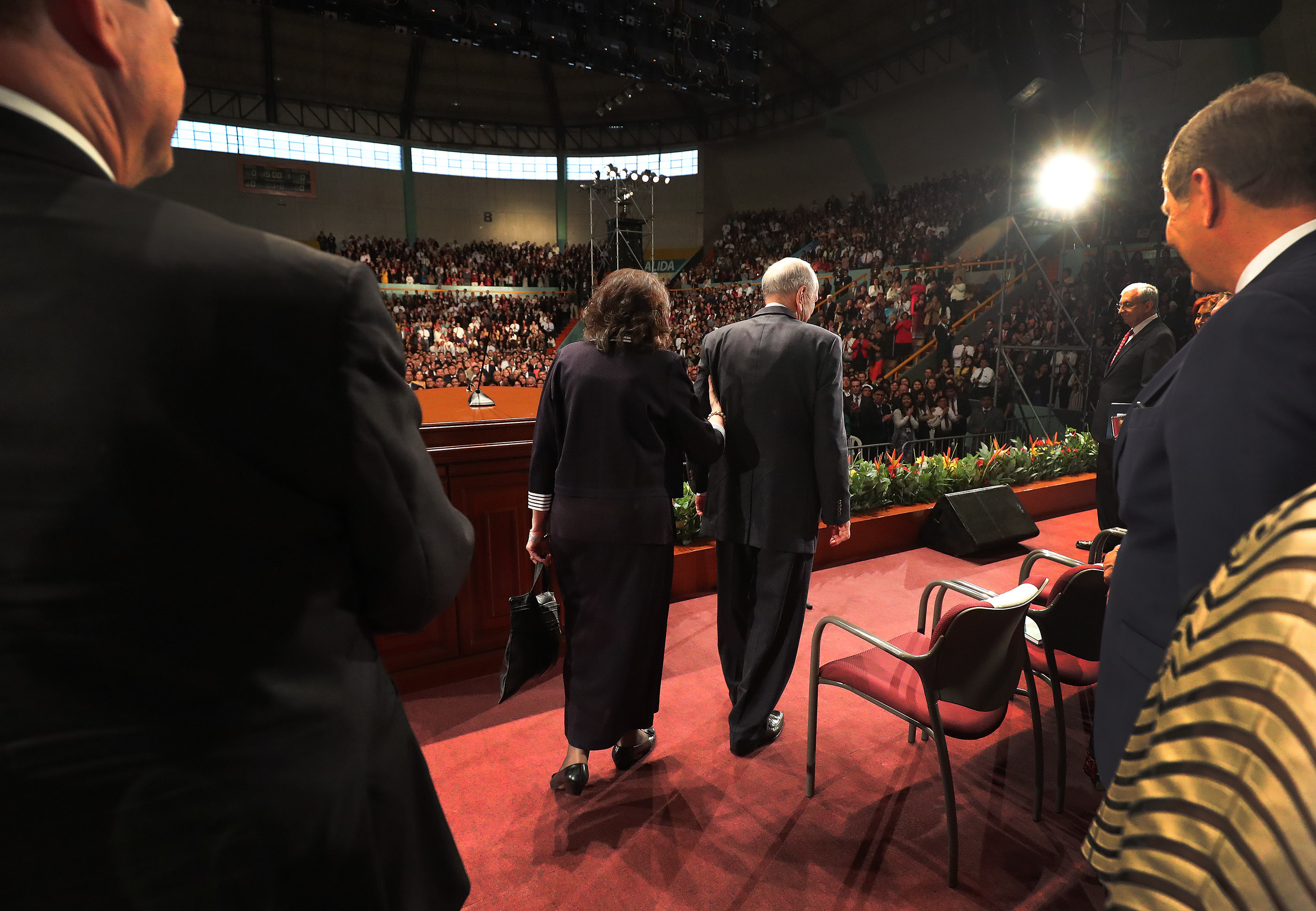 President Russell M. Nelson of The Church of Jesus Christ of Latter-day Saints walks with his wife, Sister Wendy Nelson, to the stage during a devotional meeting in Lima, Peru, on Oct. 20, 2018.
