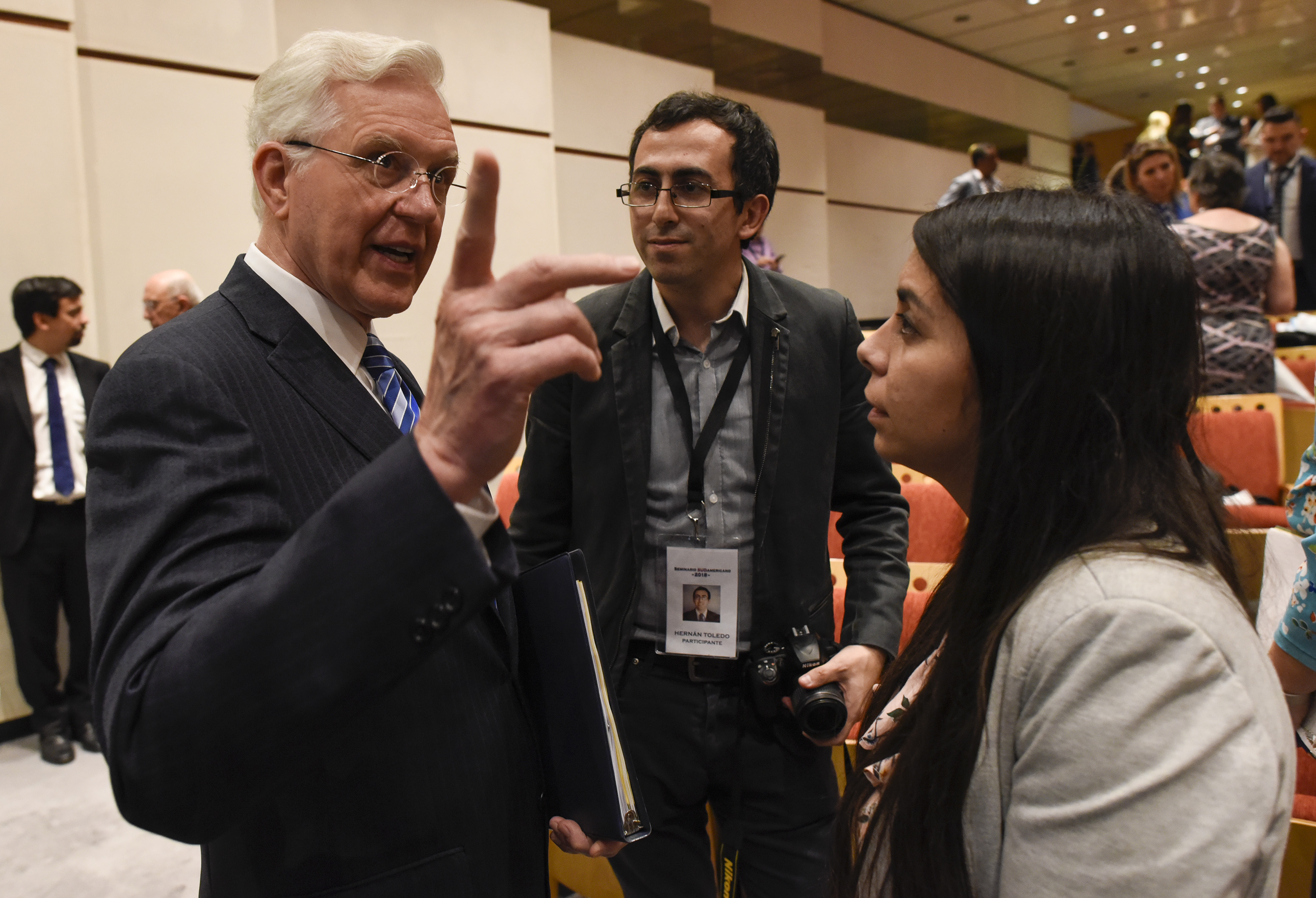 Elder D. Todd Christofferson of the Quorum of the Twelve Apostles speaks with other forum attendees during a break at the G20 Interfaith Forum in Buenos Aires, Argentina, on Wednesday, Sept. 26, 2018.
