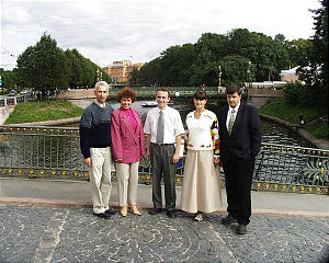 On a bridge over the Moika River with Mikhailevsky Castle in background are Valentina & Mihail Zaretsky, Alexander Nepomniaschi (seond counselor in Dist. Presidency) and Mariana and Andrei Semenov. The Semenov's were the first Russian couple to be sealed in the Temple. They are from Vyborg.
