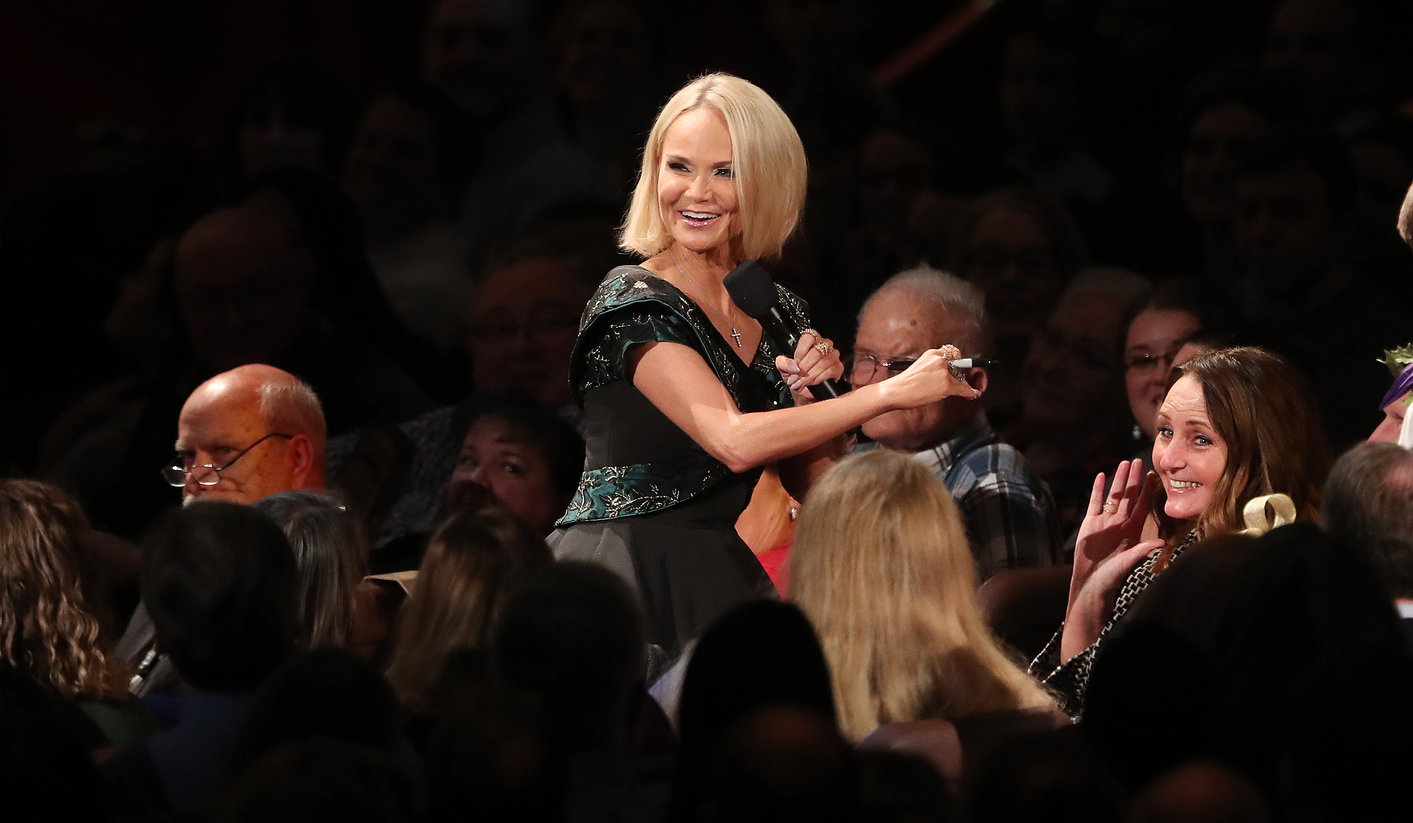 Kristin Chenoweth talks with audience members while singing with the Tabernacle Choir at Temple Square during their opening Christmas concert at the Conference Center in Salt Lake City on Thursday, Dec. 13, 2018.