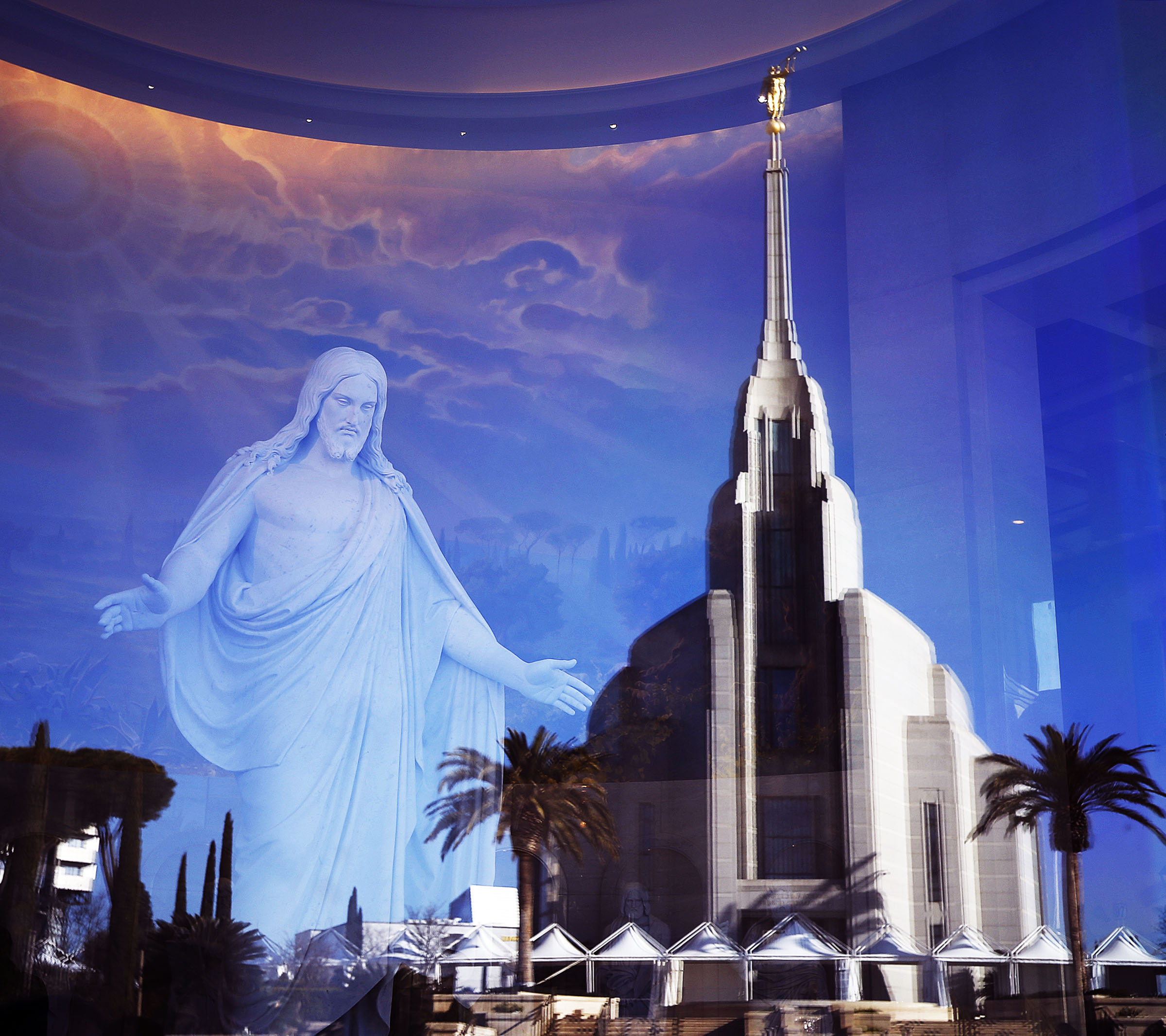The Rome Italy Temple is reflected in the window of the Rome Temple Visitor's Center of The Church of Jesus Christ of Latter-day Saints on Monday, Jan. 14, 2019.
