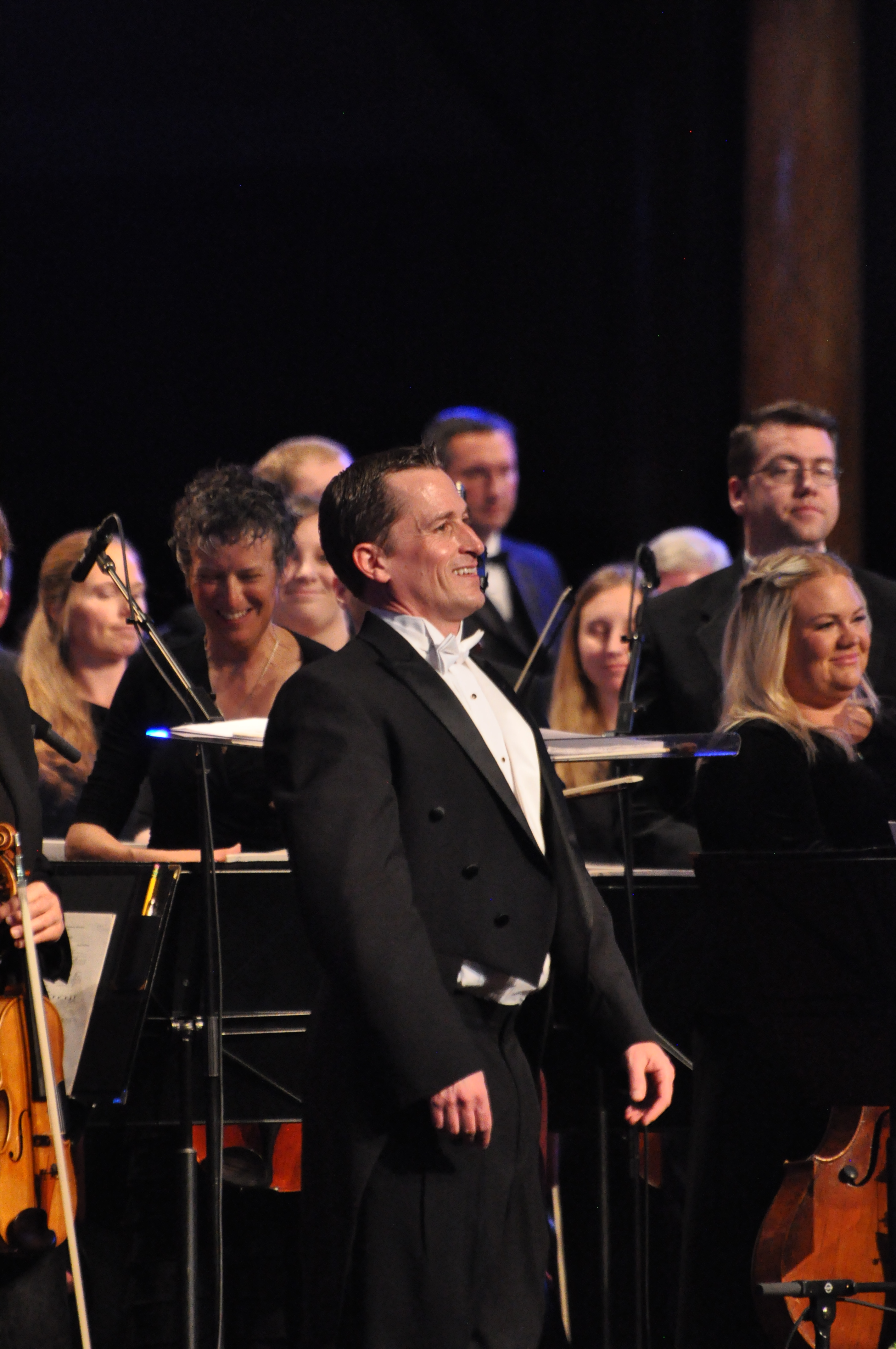 Ryan Murphy stands in front of the Orchestra at Temple Square after a performance on April 30.