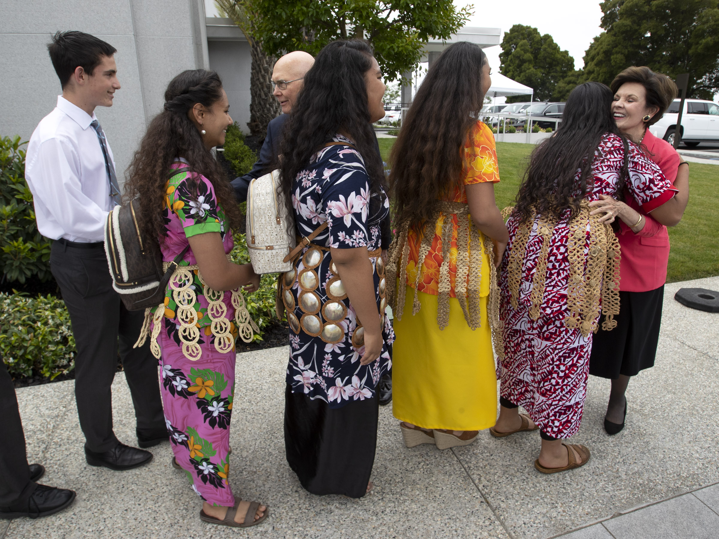 President Dallin H. Oaks, first counselor in the First Presidency of The Church of Jesus Christ of Latter-day Saints, and his wife, Sister Kristen Oaks, greet youth from East Oakland, Calif. prior to a youth devotional at the Interstake Center on the Oakland California Temple grounds on Saturday, June 15, 2019.