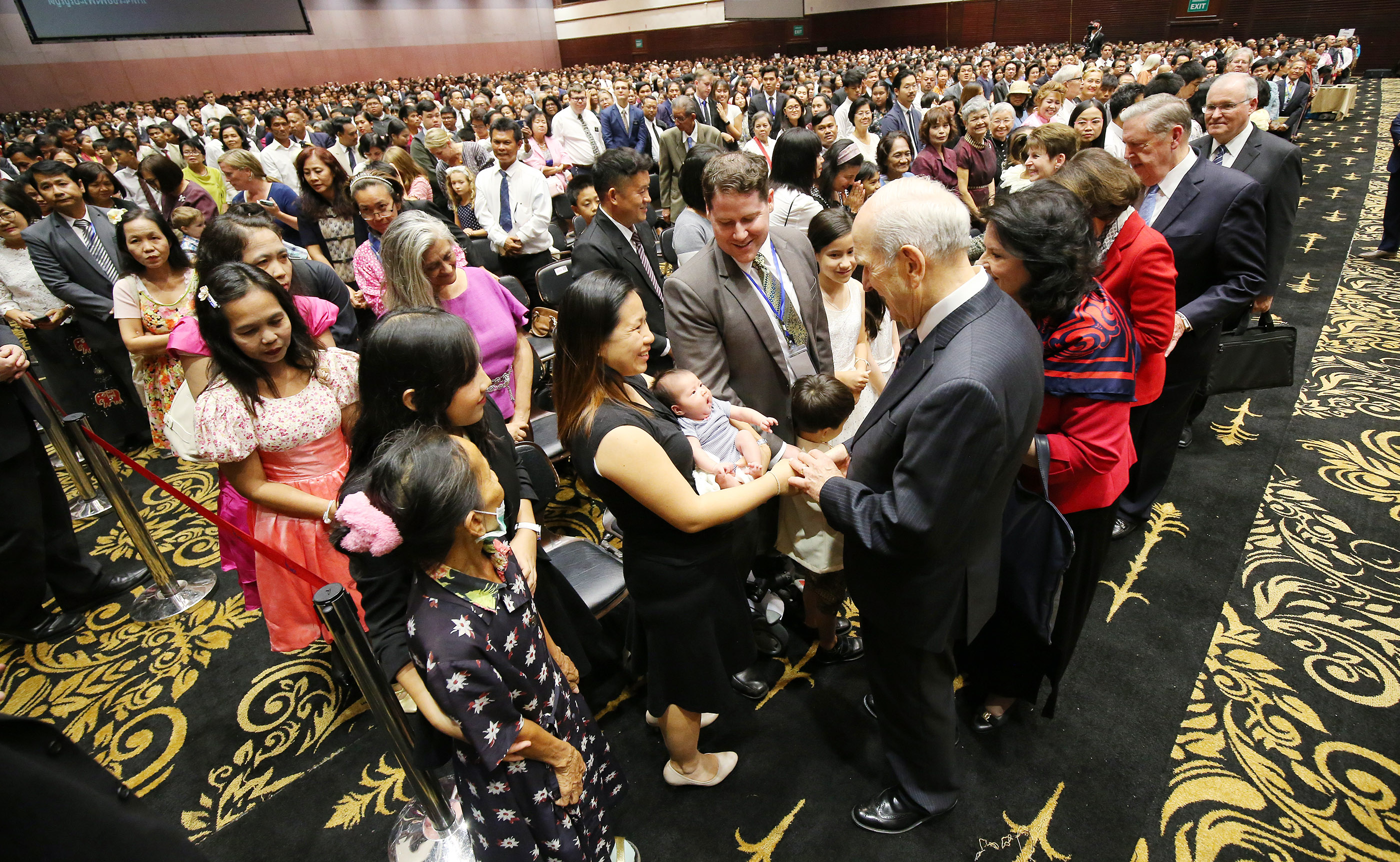 President Russell M. Nelson and his wife, Sister Wendy Nelson, and Elder Jeffrey R. Holland, Quorum of the Twelve Apostles, and Sister Patricia Holland shake hands after a devotional in Bangkok, Thailand, on Friday, April 20, 2018.
