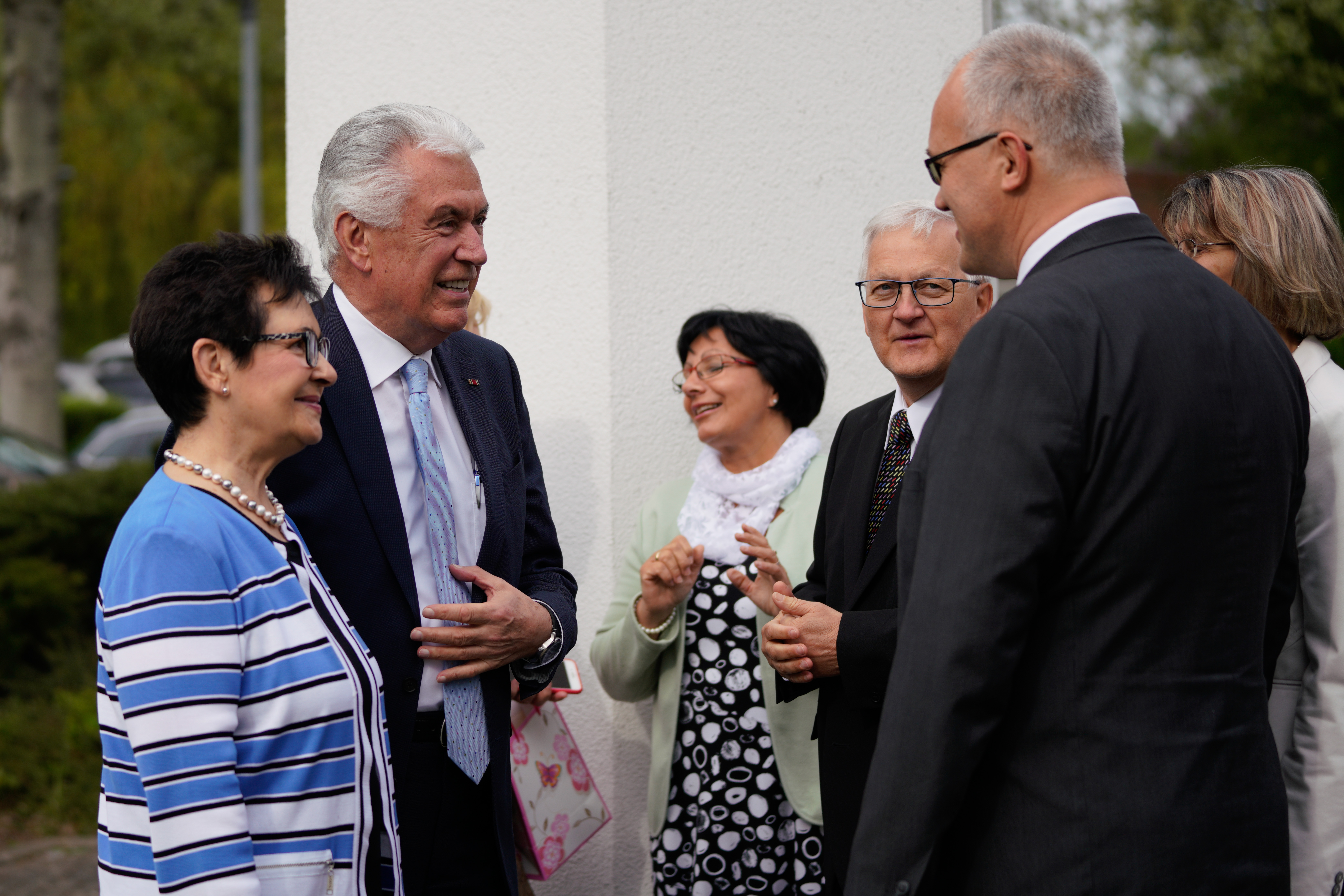 Elder Dieter F. Uchtdorf and Sister Harriet Uchtdorf greet members following a sacrament meeting and branch conference with the Görlitz Branch on April 28, 2019, in Görlitz, Germany.