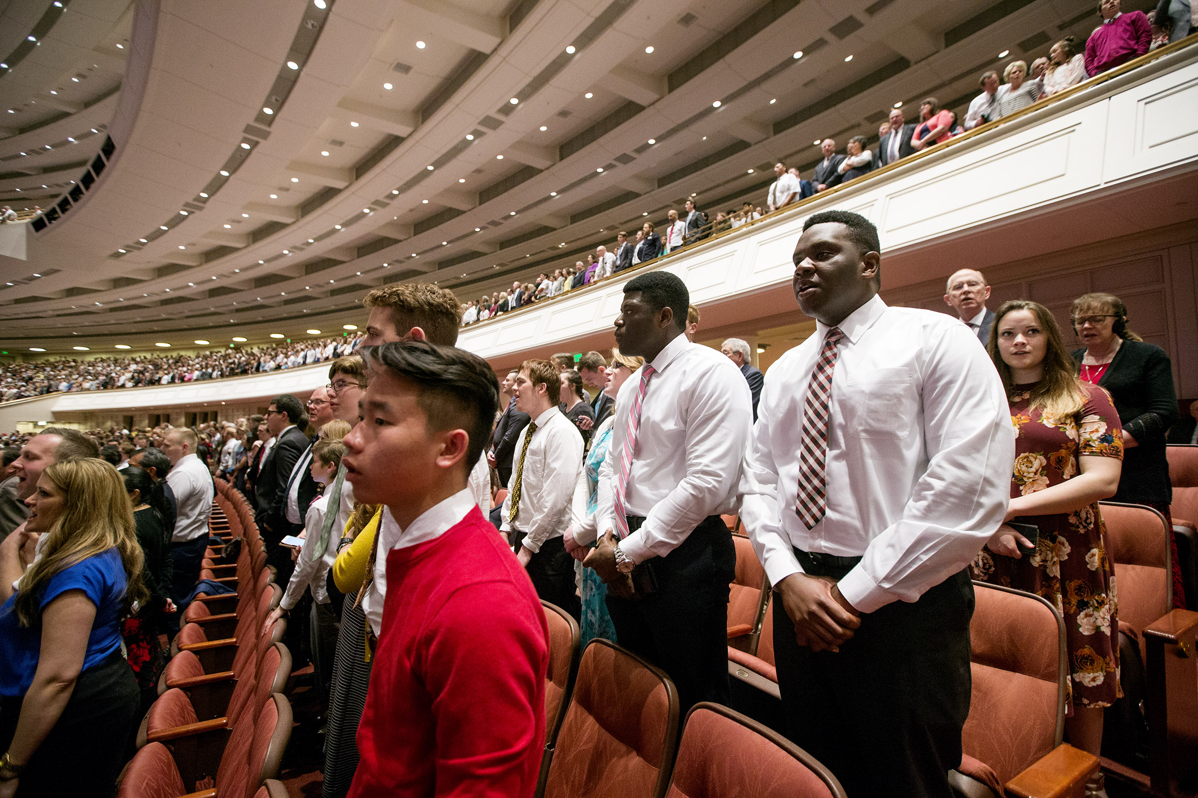 Conferencegoers stand and sing as they attend the Sunday afternoon session of the 188th Annual General Conference of The Church of Jesus Christ of Latter-day Saints in the Conference Center in Salt Lake City on Sunday, April 1, 2018.