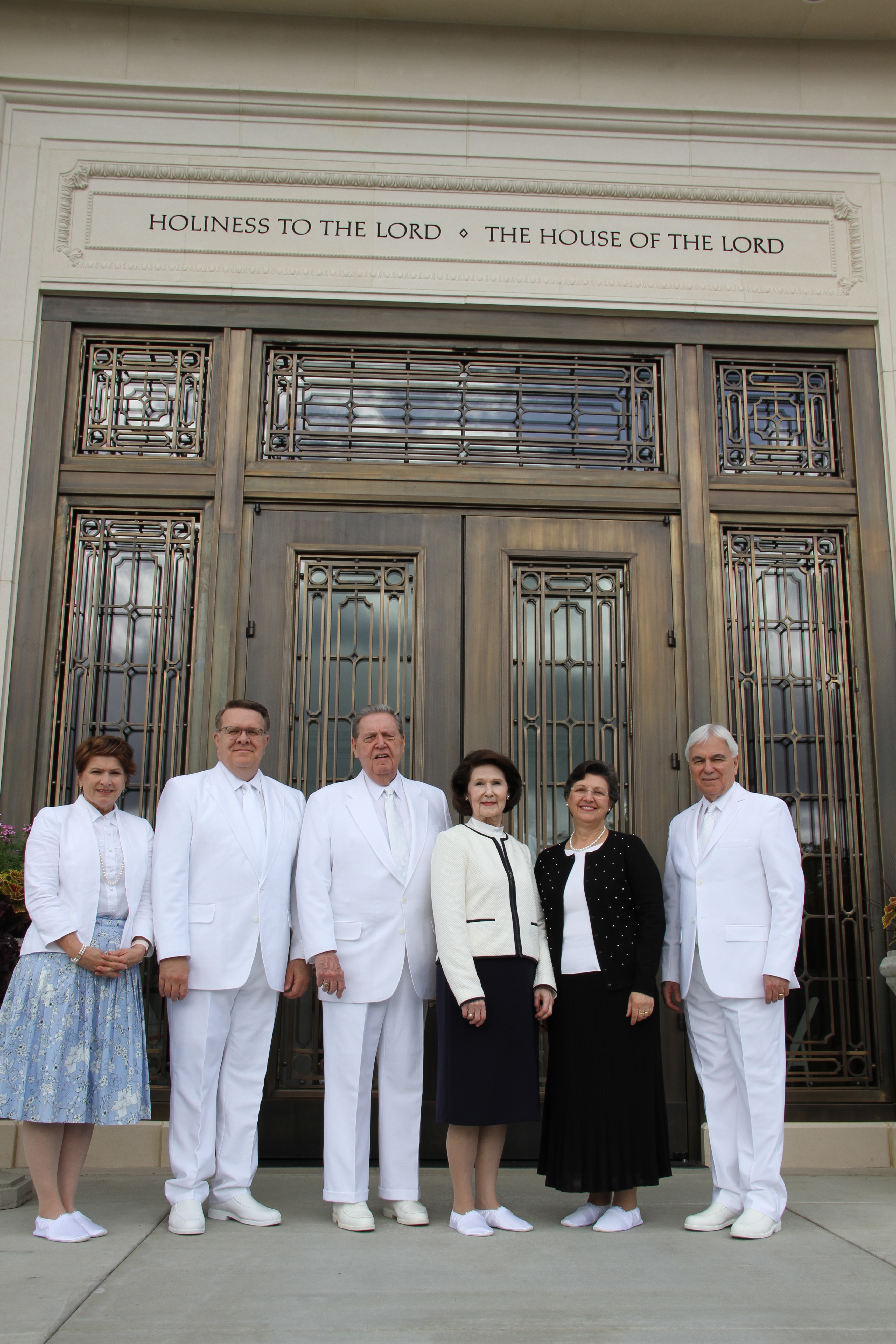 From left, Sister Jeri Whiting, Elder Scott D. Whiting, Elder Jeffrey R. Holland, Sister Patricia Holland, Sister Margareth Costa and Elder Claudio R. M. Costa pose in front of the temple prior to the rededication ceremony on May 5, 2019.