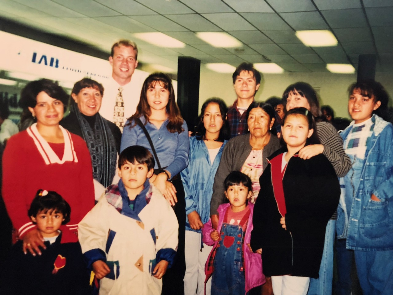 Davis Smith with several families he taught while serving in Bolivia 20 years ago. The members accompanied him to the airport when he was transferred from their area.