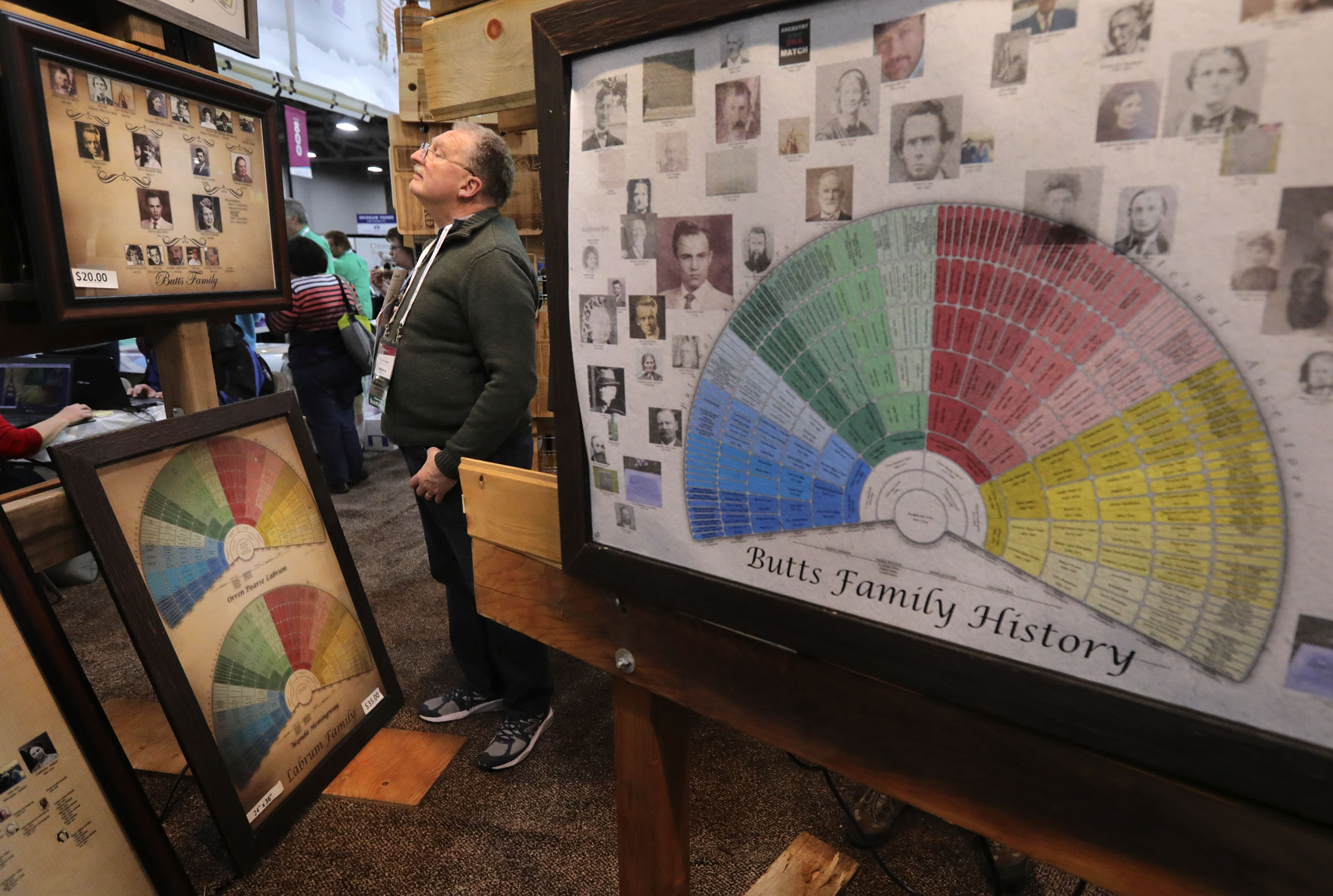 Fred Graham looks at Genealogy WallCharts displays during RootsTech at the Salt Palace Convention Center in Salt Lake City on Thursday, Feb. 28, 2019.