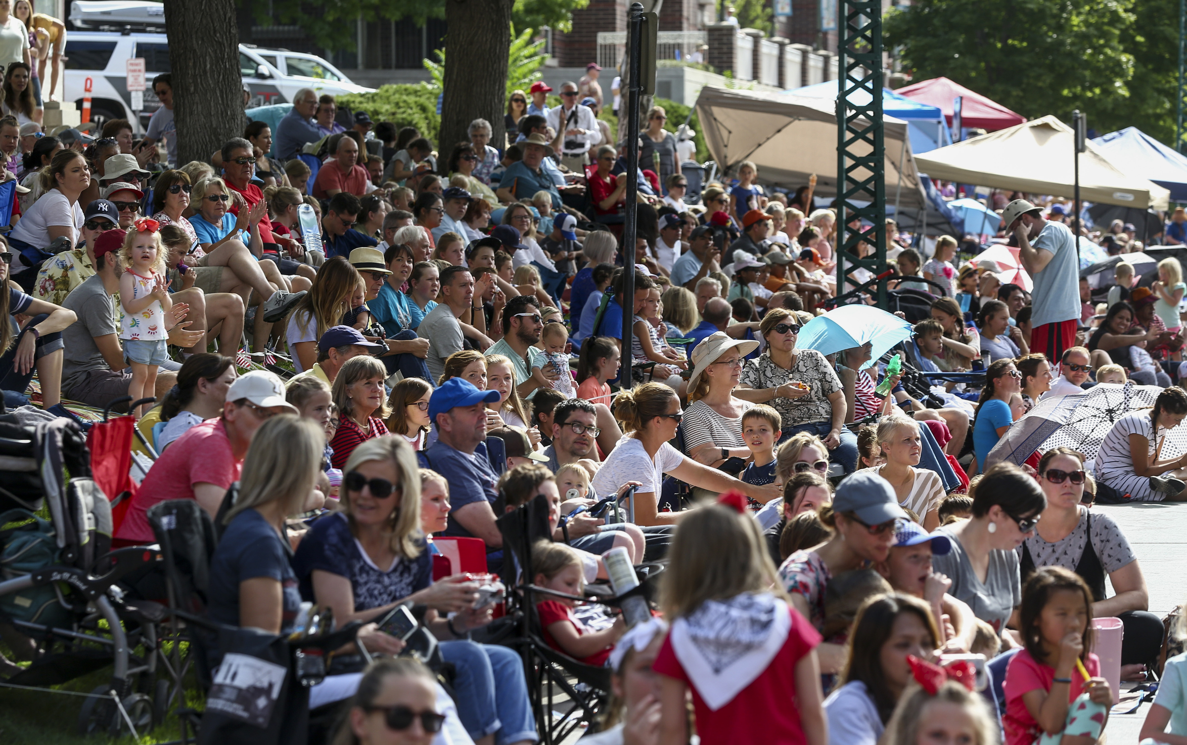 Hundreds pack South Temple street as the Days of '47 Parade passes by in Downtown Salt Lake City on Wednesday, July 24, 2019.