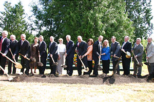 Elder Ronald A. Rasband, center, leads Elder William R. Walker, at his left, and local priesthood and civic leaders and wives in breaking ground for the new Vancouver British Columbia Temple, the seventh in Canada.