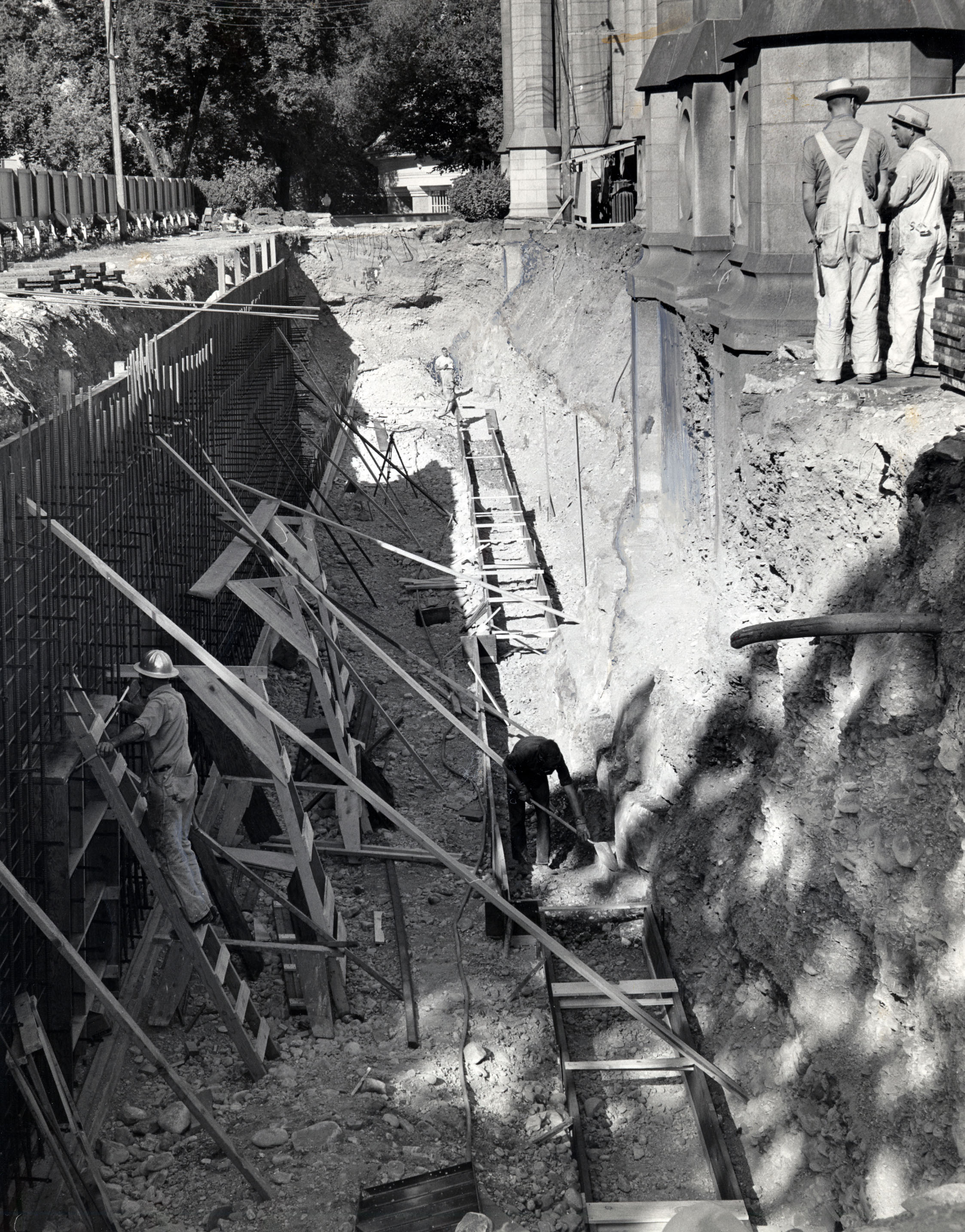 Workmen set forms for new entrance to south side of the Salt Lake Temple, exposing base stones 20 feet thick that hold up granite walls. Sept. 15, 1962 Ralph T. Clark, Deseret News archives