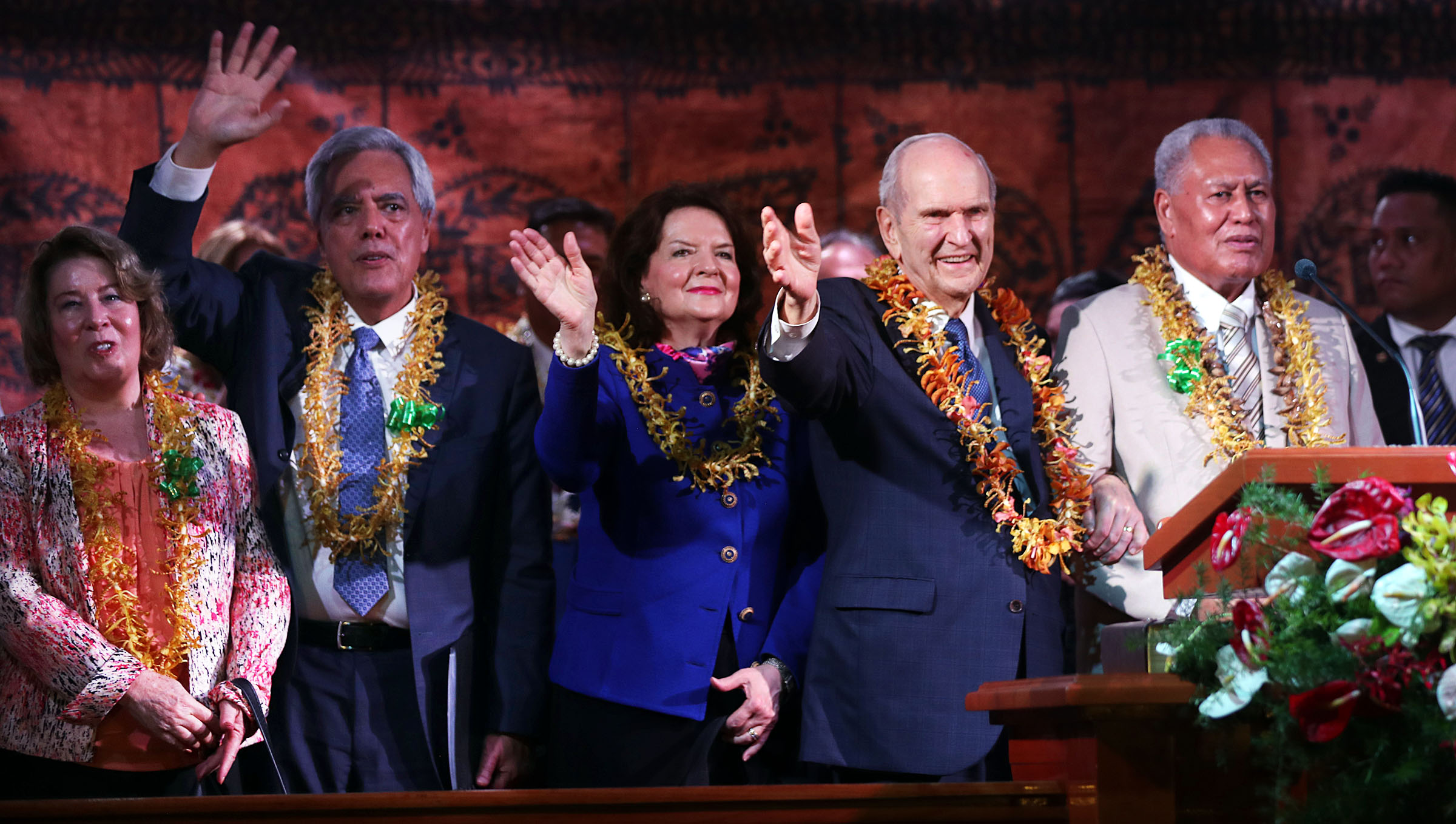 President Russell M. Nelson of The Church of Jesus Christ of Latter-day Saints and his wife, Sister Wendy Nelson, at center, wave to those in attendance at the end of a devotional in Apia, Samoa, on Saturday, May 18, 2019.