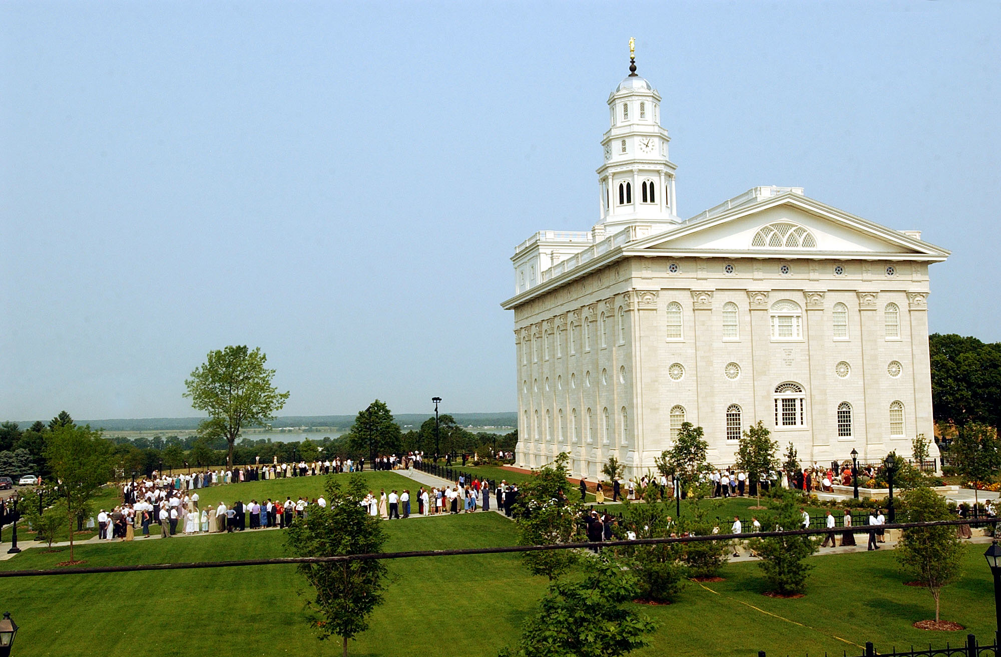 Church members wait to enter the Nauvoo Illinois Temple during one 13 dedicatory sessions held June 27-30, 2002.