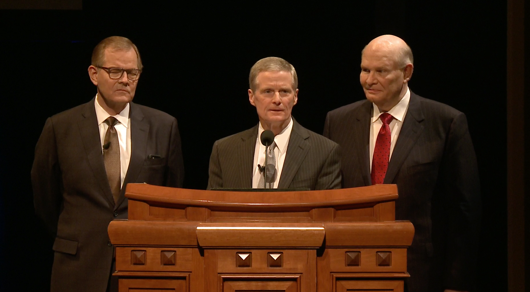 Apostles Elder Gary E. Stevenson, Elder David A. Bednar and Elder Dale G. Renlund participate in an instruction meeting for ward and stake leaders and members involved in temple and family history work. The image is from a screenshot from the Feb. 28 broadcast.