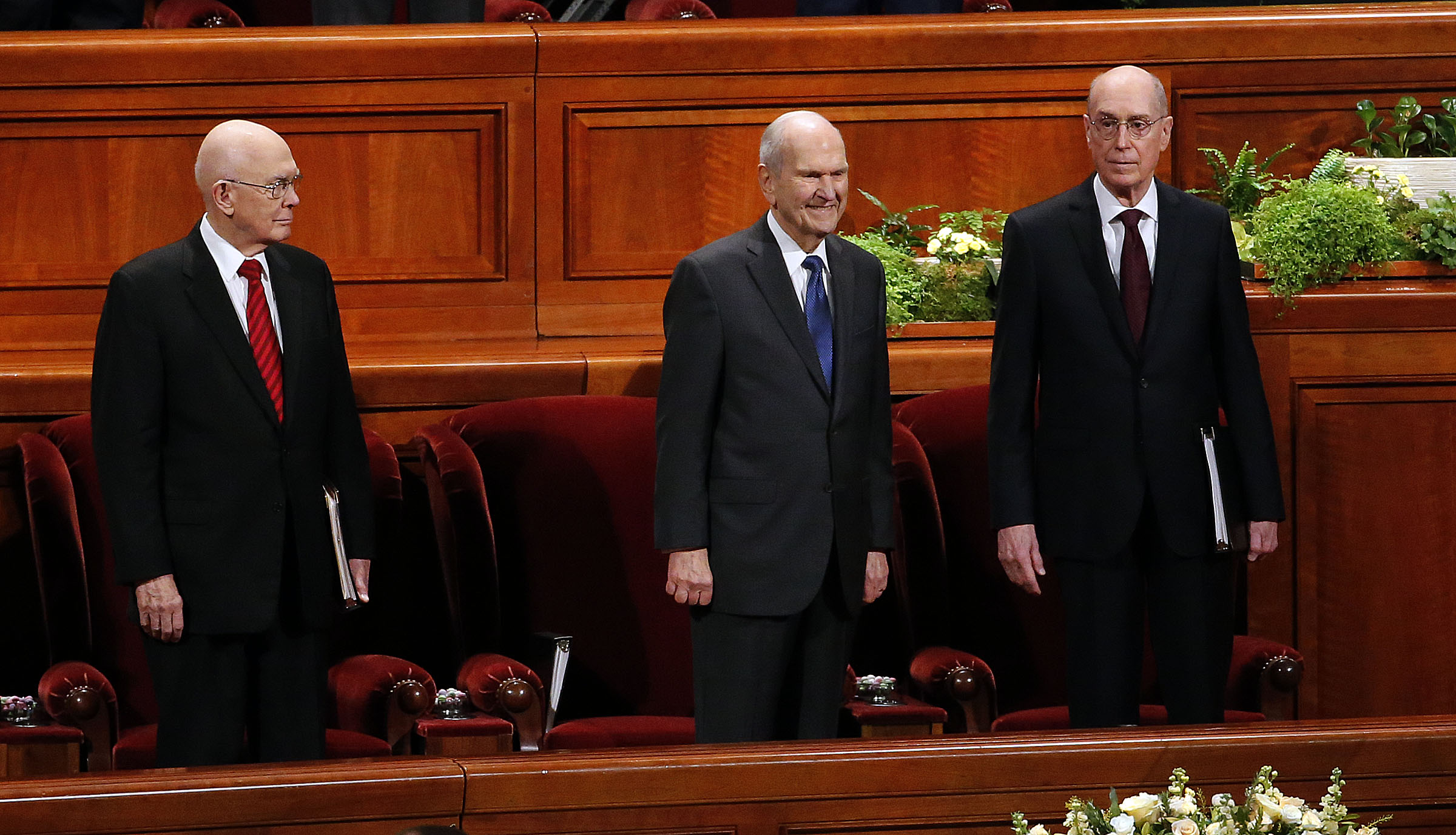 Members of the First Presidency stand before taking their seats for the Church's 188th Annual General Conference in Salt Lake City on Saturday, March 31, 2018.