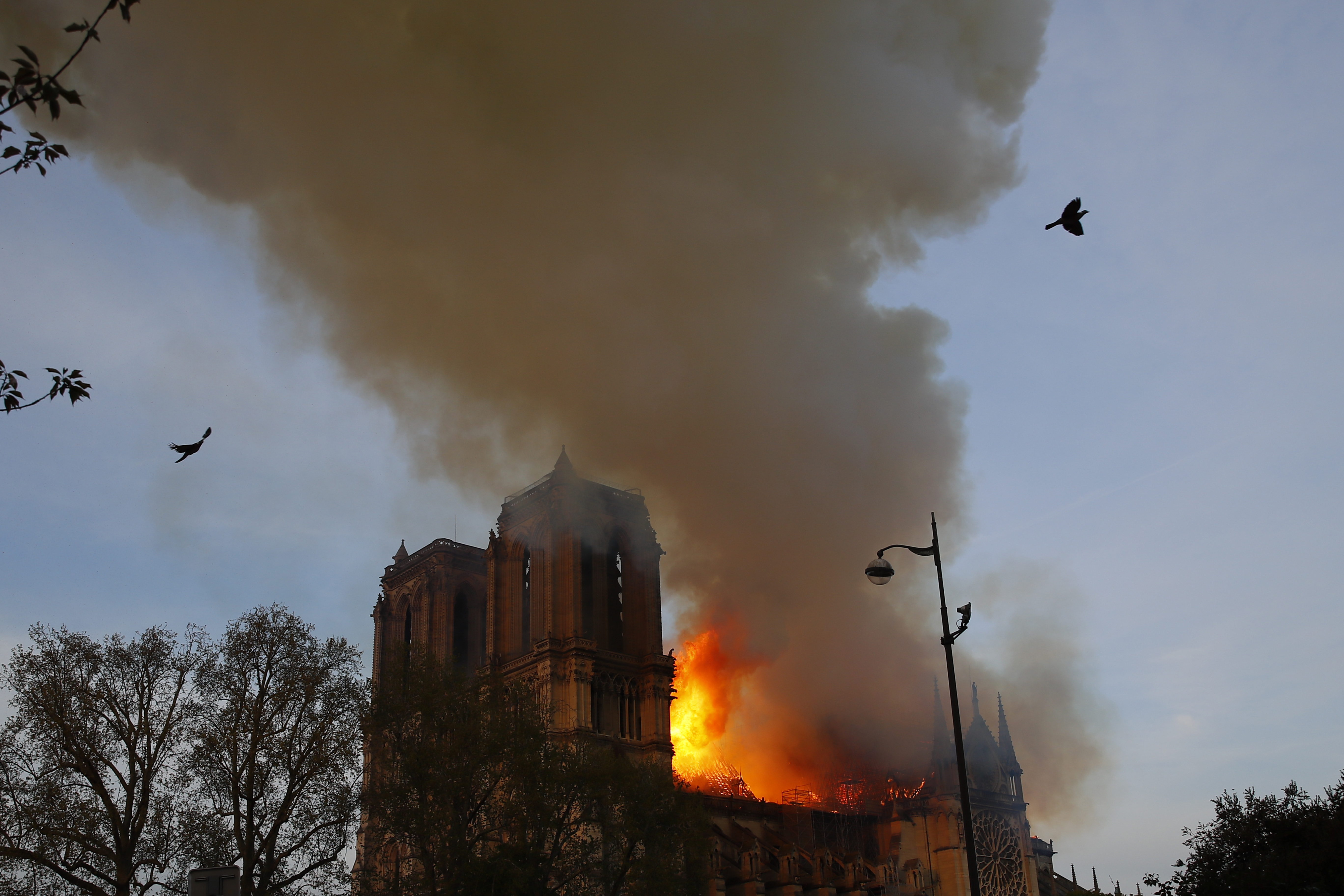 Notre Dame cathedral is burning in Paris, Monday, April 15, 2019. A catastrophic fire engulfed the upper reaches of Paris' soaring Notre Dame Cathedral as it was undergoing renovations Monday, threatening one of the greatest architectural treasures of the Western world as tourists and Parisians looked on aghast from the streets below. (AP Photo/Francois Mori)
