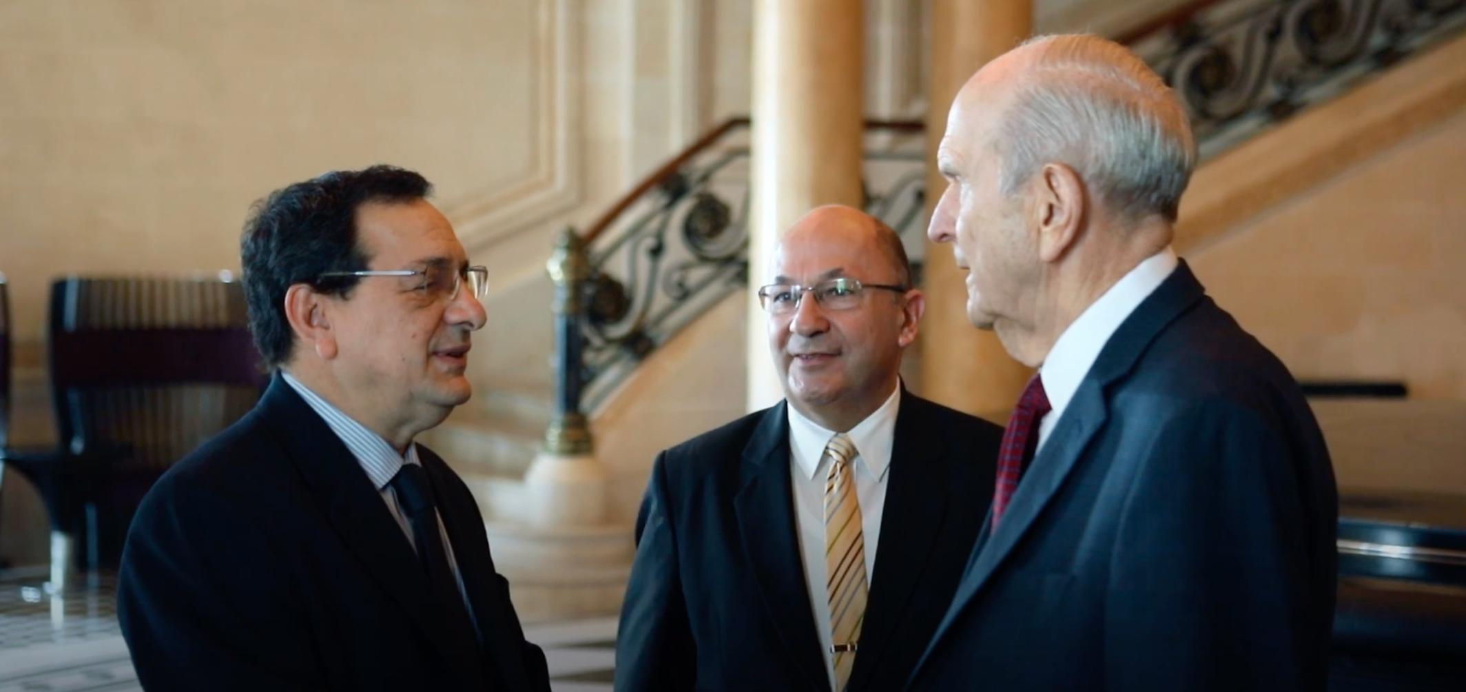 Sergio Rubin, left, speaks with President Russell M. Nelson.