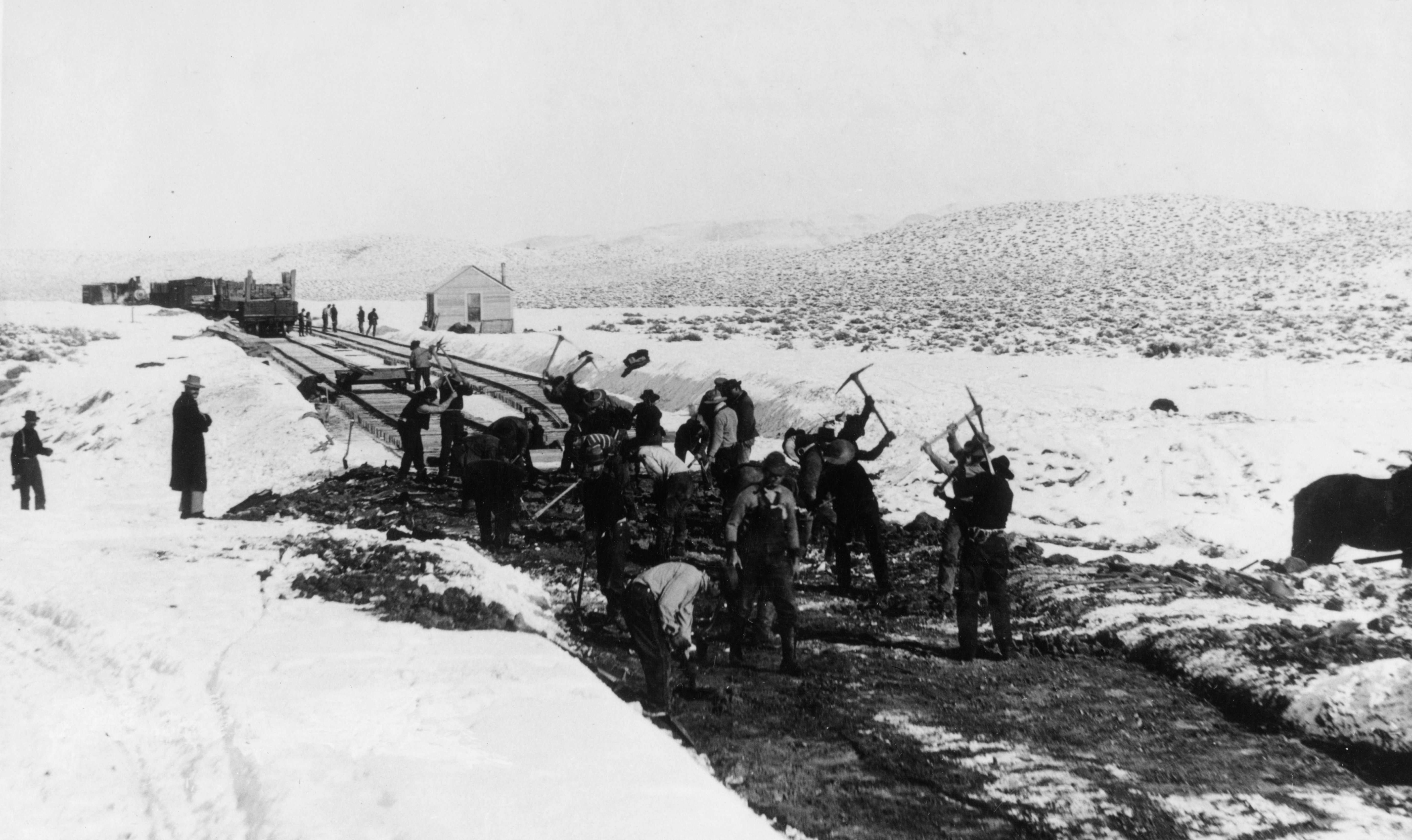 Workers construct the Deep Creek Railroad in Nevada.