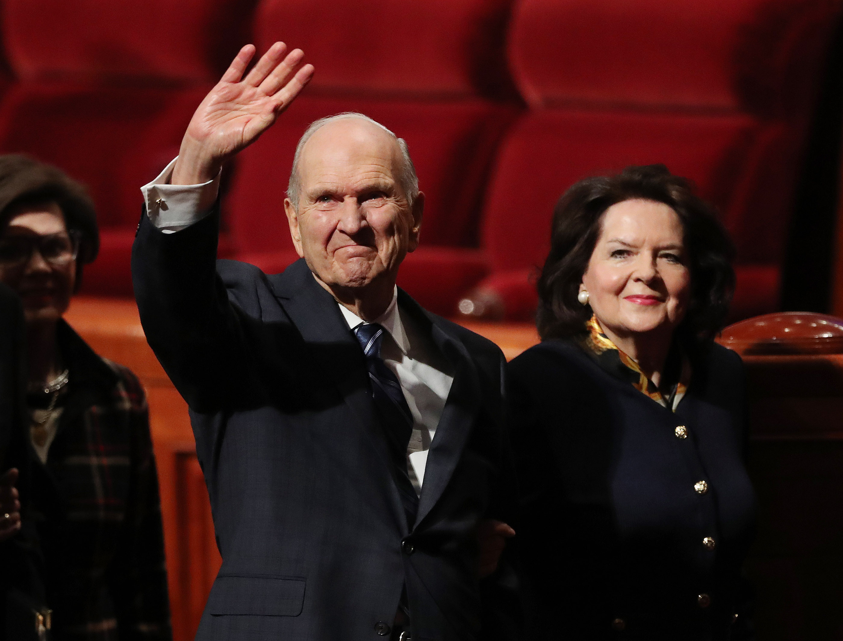 President Russell M. Nelson waves to attendees with his wife, Sister Wendy Nelson, after the Sunday morning session of the 188th Semiannual General Conference of The Church of Jesus Christ of Latter-day Saints in Salt Lake City on Sunday, Oct. 7, 2018.