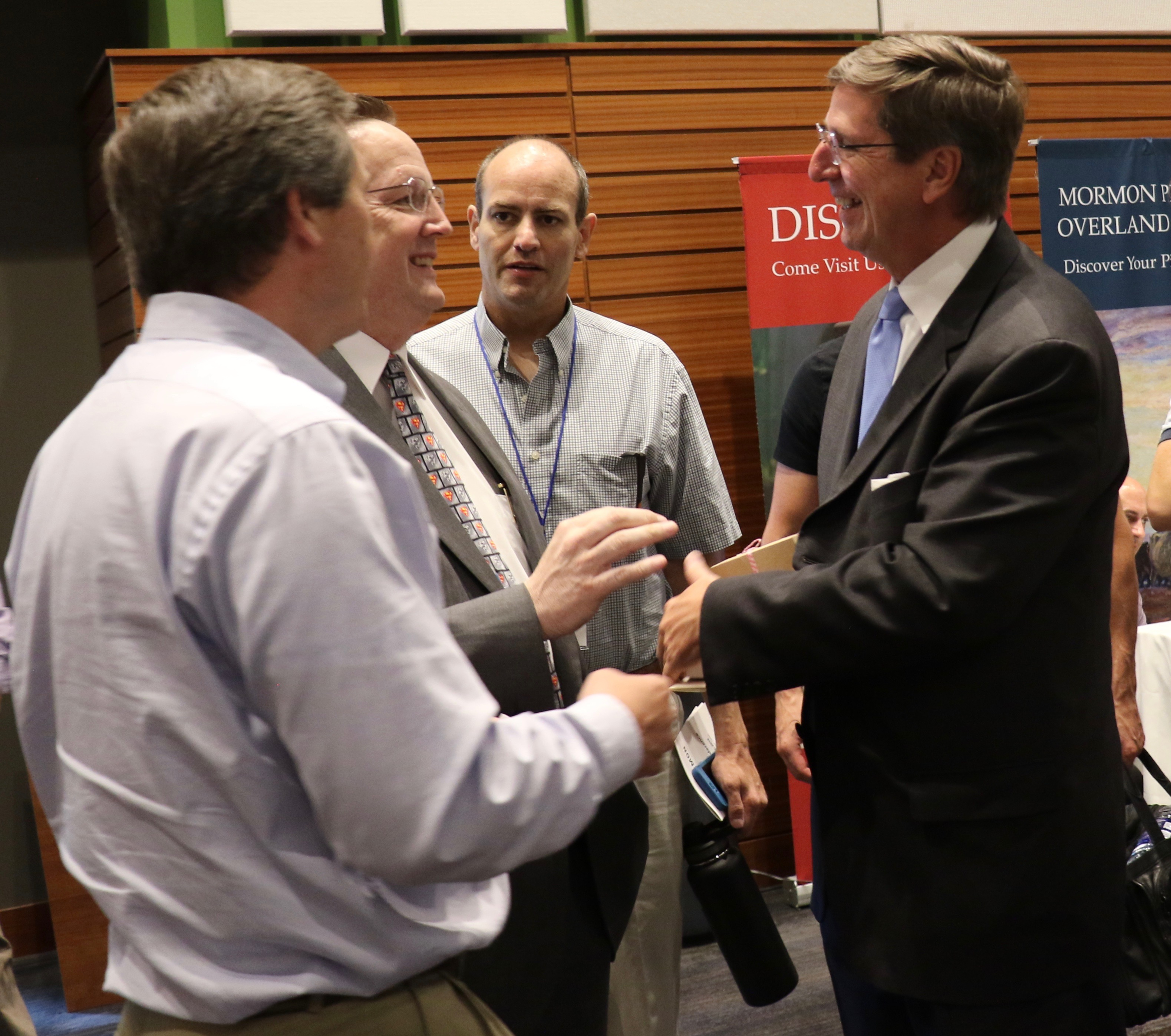 Elder Kevin W. Pearson, right, speaks with attendees of the 2018 FairMormon Conference on Aug. 3, 2018, following his presentation calling on individual Latter-day Saints to utilize social media to share the gospel.